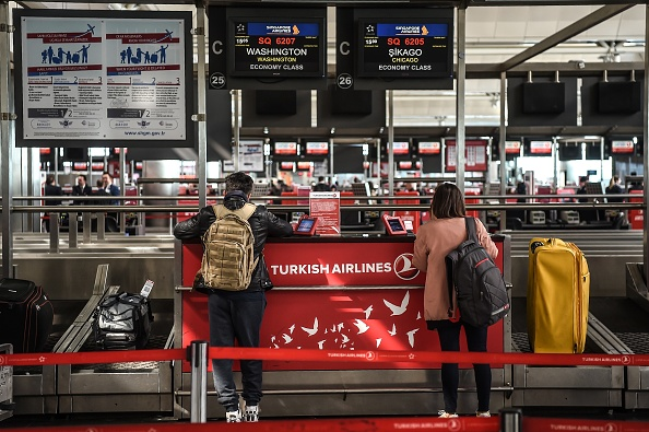 U.S. passengers queue at a check-in area on March 22, 2017 at the Ataturk International Airport in Istanbul.