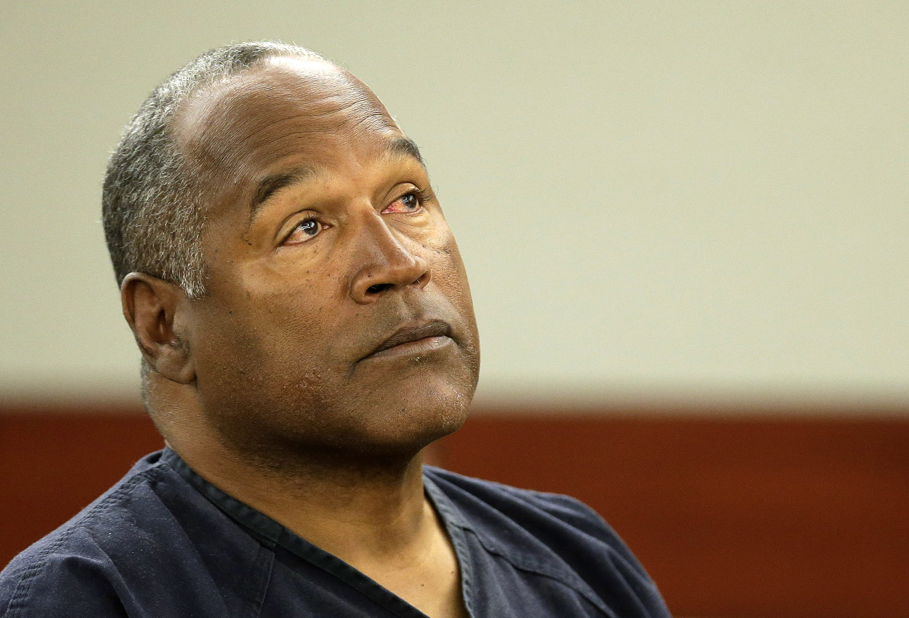 O.J. Simpson listens to testimony at an evidentiary hearing in Clark County District Court May 13, 2013 in Las Vegas, Nevada.