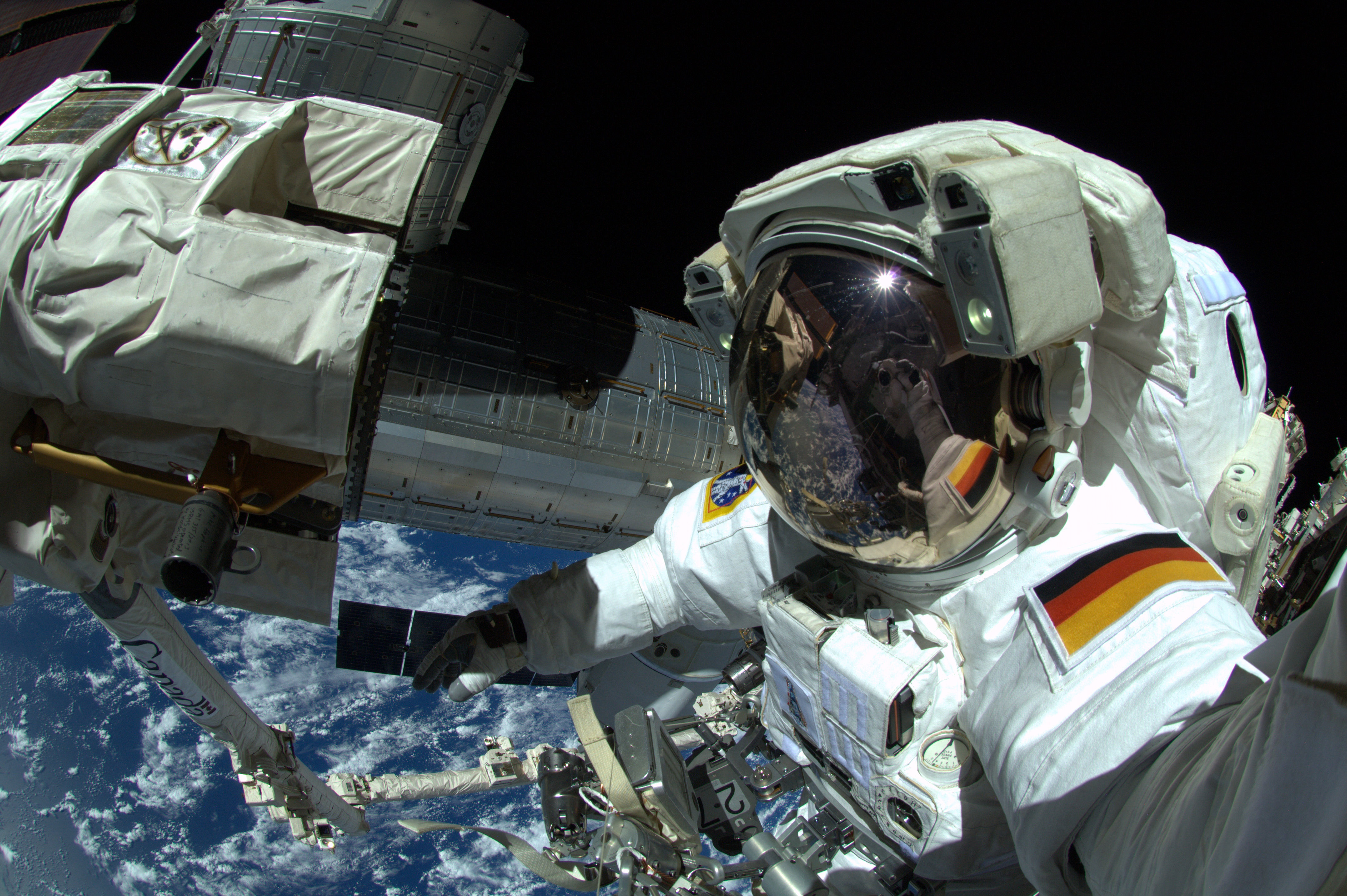 In this handout photo provided by the European Space Agency (ESA), German ESA astronaut Alexander Gerst takes a 'selfie' during his spacewalk, whilst aboard the International Space Station (ISS) on October 7, 2014 in Space.