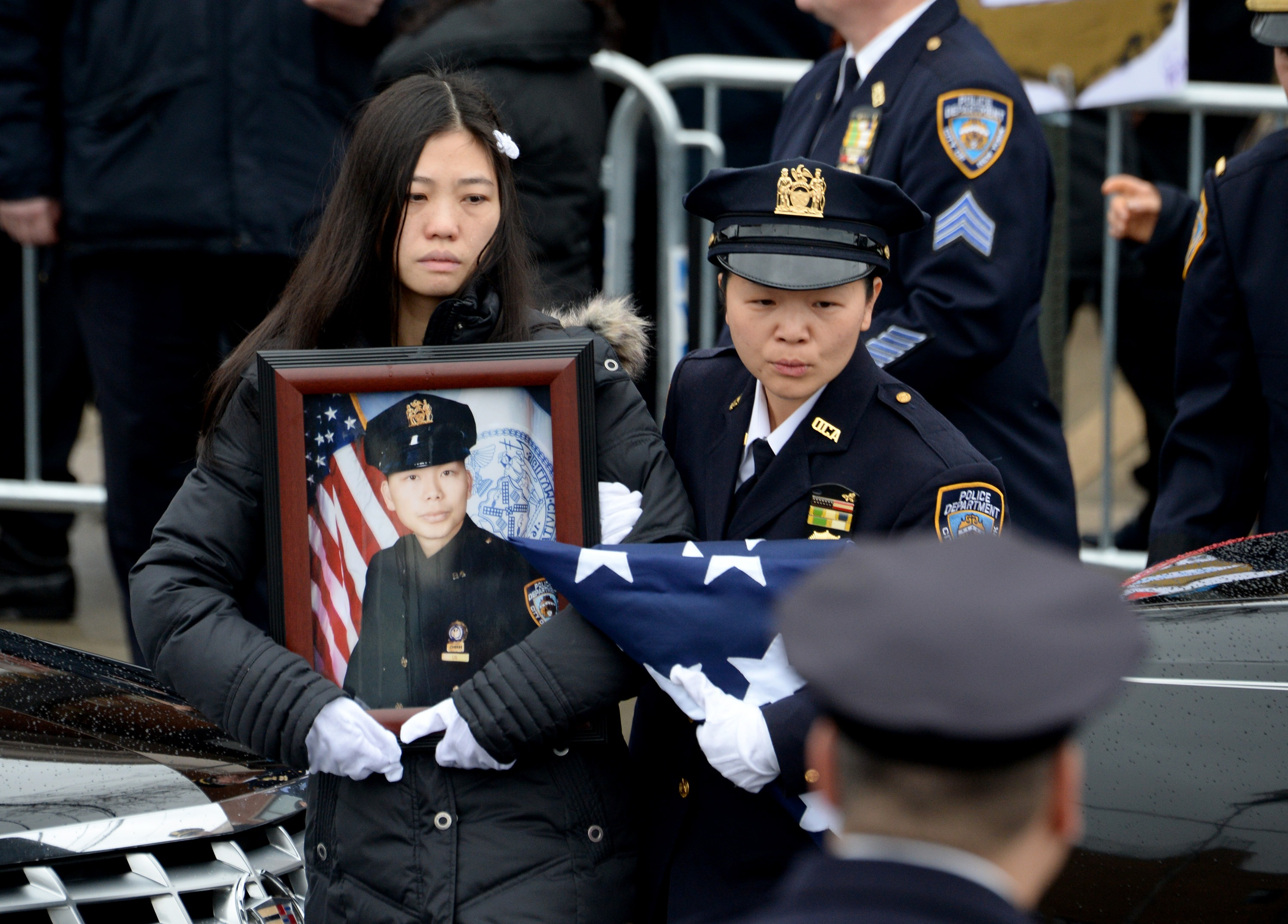 Pei Xia Chen, widow of New York Police Officer Wenjian Liu, during his funeral on Jan. 4, 2015 in the Brooklyn borough of New York City.