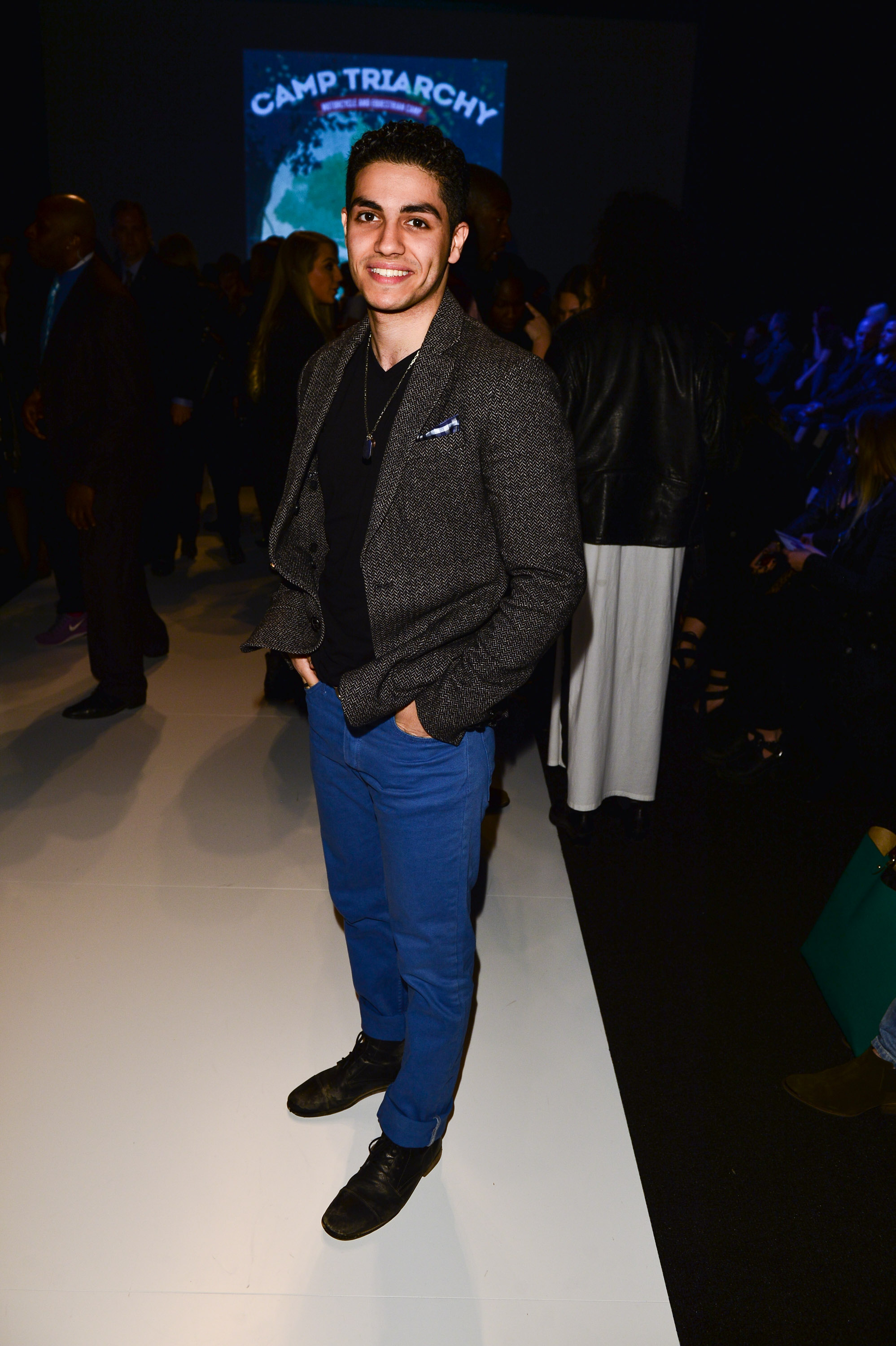 Actor Mena Massoud attends World MasterCard Fashion Week Fall 2015 Collections Day 3 at David Pecaut Square on March 25, 2015 in Toronto, Canada.