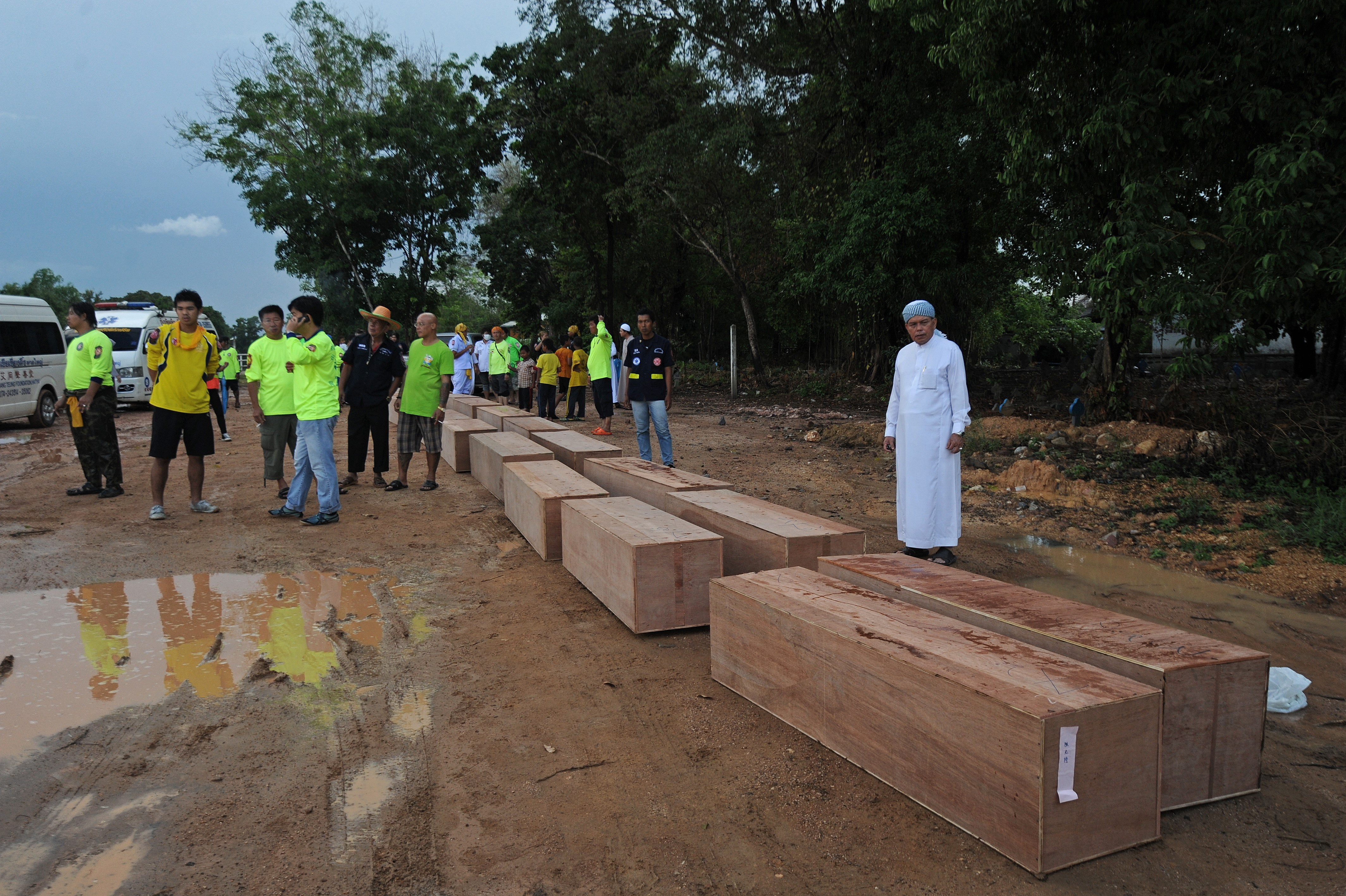 Rescue workers carry the remains of migrants exhumed from a mass grave in Songkhla, Thailand, on May 3, 2015.