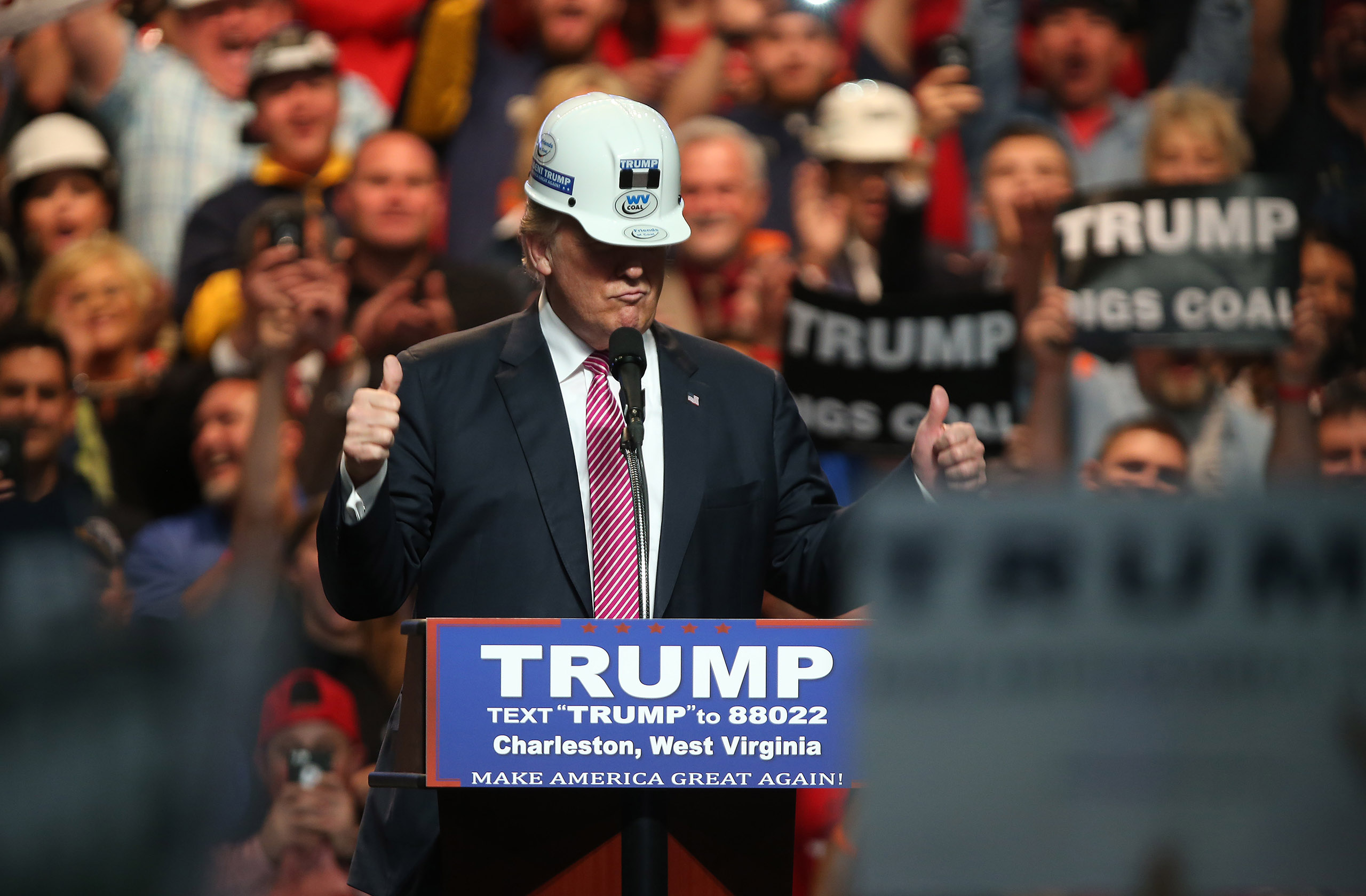 Republican Presidential candidate Donald Trump models a hard hat in support of the miners during his rally at the Charleston Civic Center on May 5, 2016 in Charleston, West Virginia.