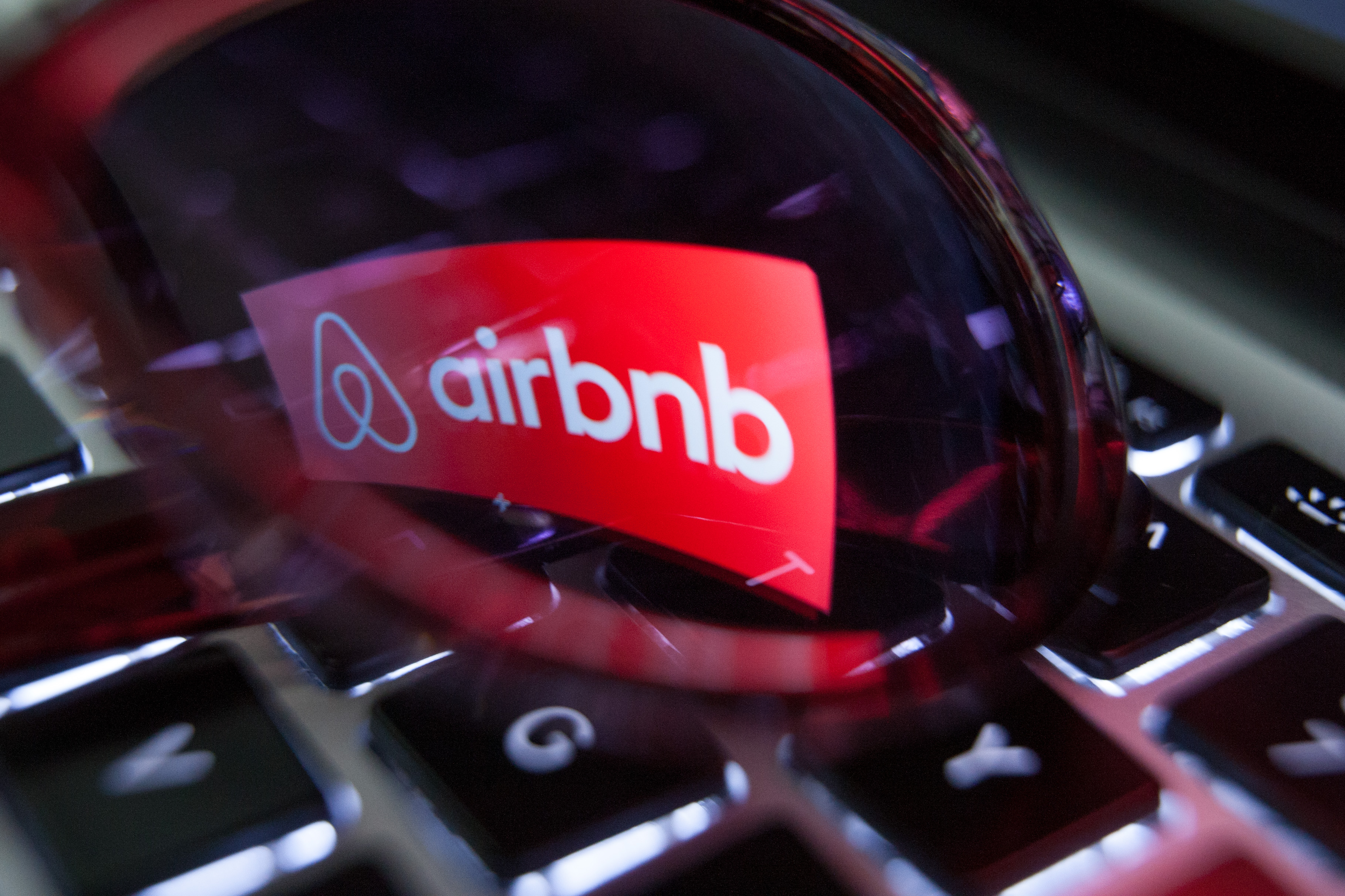 This undated photos shows the logo of Airbnb reflected on a pair of sunglasses.