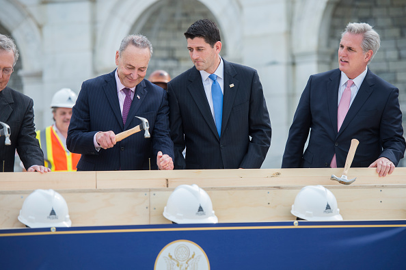 Speaker Paul Ryan, R-Wis., reacts to the technique of Sen. Charles Schumer, D-N.Y., as Senate Majority Leader Mitch McConnell, R-Ky., far left, and House Majority Leader Kevin McCarthy, R-Calif., participate in a First Nail Ceremony that launches the construction of the Inaugural platform on the West Front of the Capitol, September 21, 2016.
