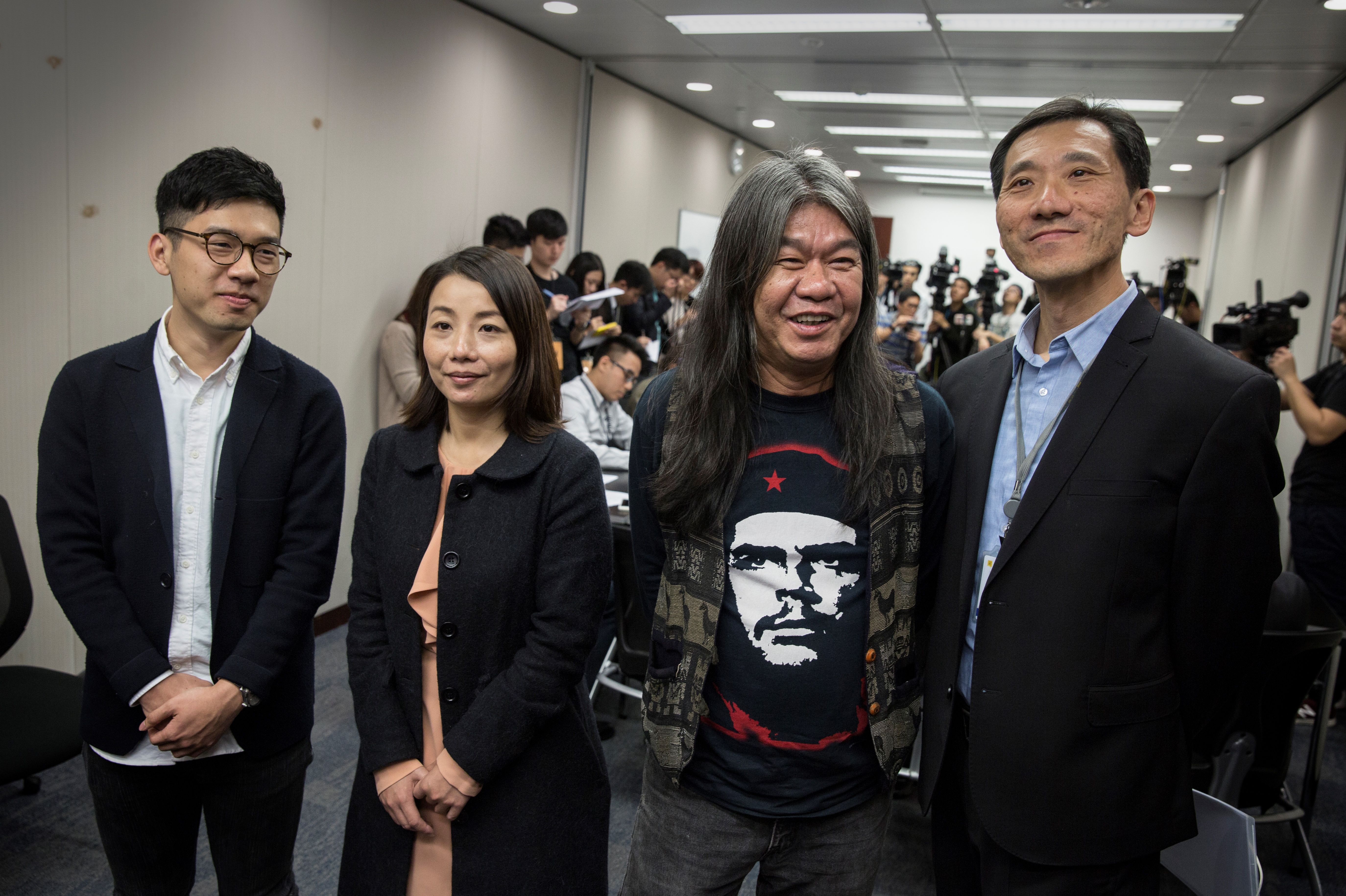 This Dec. 22, 2016 phoyo shows Hong Kong Legislative Council members Nathan Law (L), Lau Siu-lai (2nd L), Leung Kwok-hung (2nd R) and Edward Yiu (R) at a press conference addressing the judicial review brought by the government over each of their oath-taking.