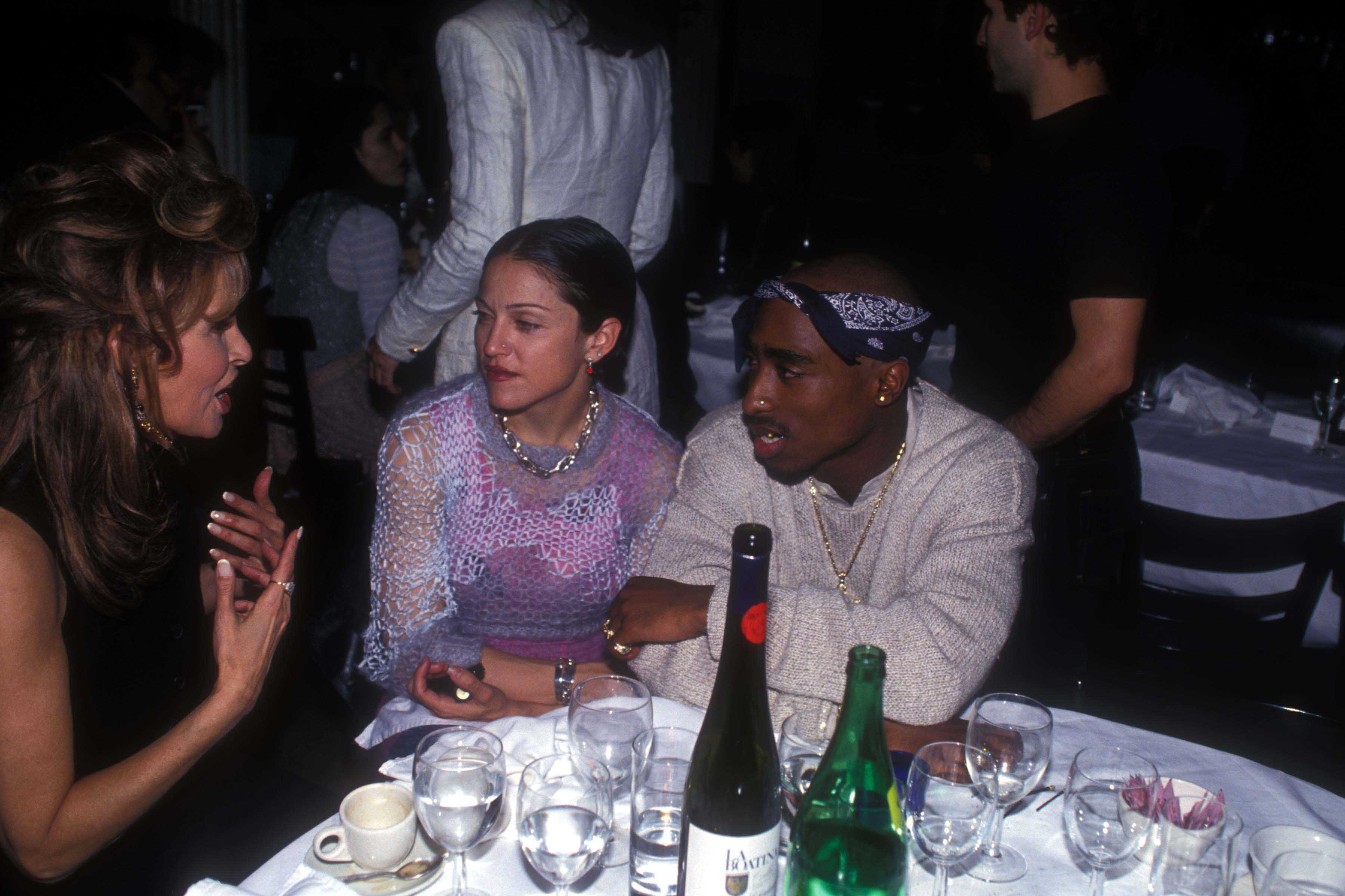 (L-R) Raquel Welch, Madonna and Tupac Shakur at the Interview Magazine party, March 1, 1994 in New York.