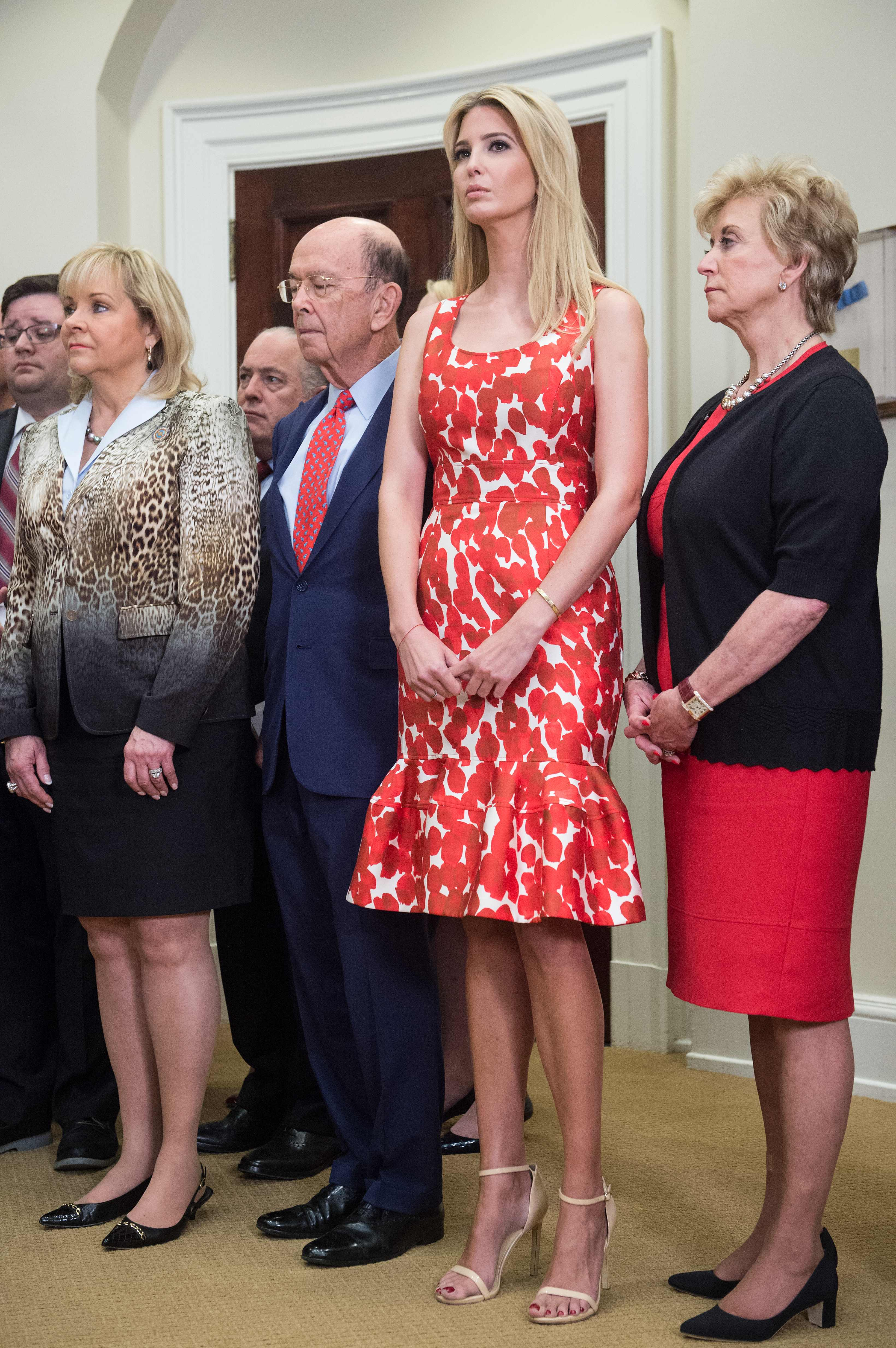 Ivanka Trump (2nd R), daughter and adviser of US President Donald Trump, listens to her father speak during the launch of the Apprenticeship and Workforce of Tomorrow initiatives in the Roosevelt Room at the White House in Washington, DC, on June 15, 2017.                                From L to R, Oklahoma Governor Mary Fallin, Commerce Secretary Wilbur Ross, Trump and Small Business Administration administrator Linda McMahon. / AFP PHOTO / NICHOLAS KAMM        (Photo credit should read NICHOLAS KAMM/AFP/Getty Images)