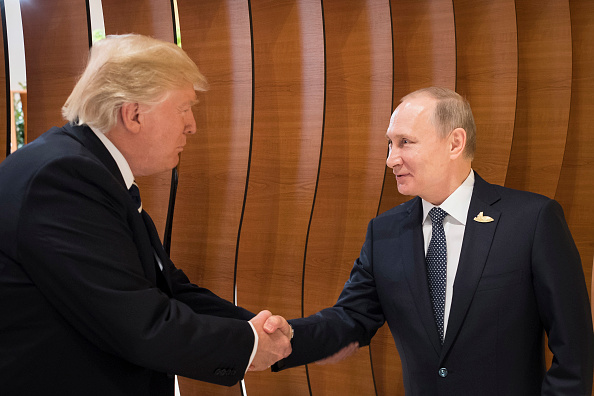 President Trump shakes hands with Russian President Vladimir Putin during the G20 meeting in Germany.