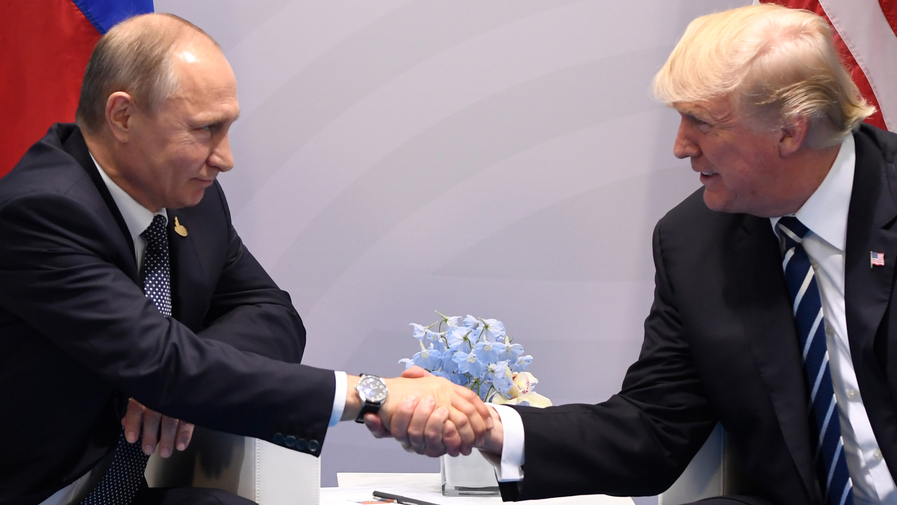 US President Donald Trump (R) and Russia's President Vladimir Putin shake hands during a meeting on the sidelines of the G20 Summit in Hamburg, Germany, on July 7, 2017.