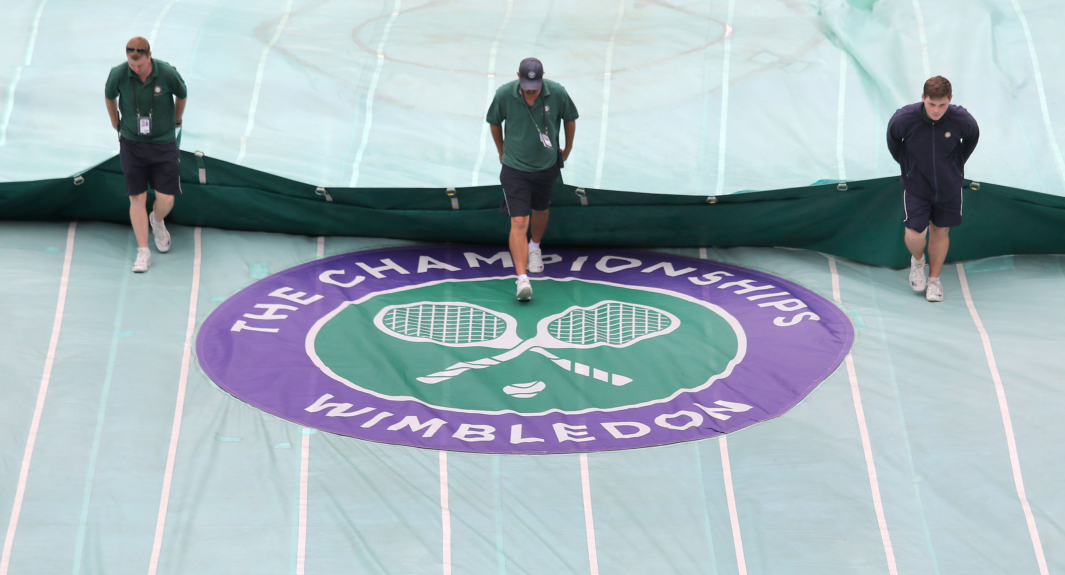 The covers are taken off on center court ahead of day eight of the Wimbledon Championships at the All England Lawn Tennis and Croquet Club, Wimbledon.