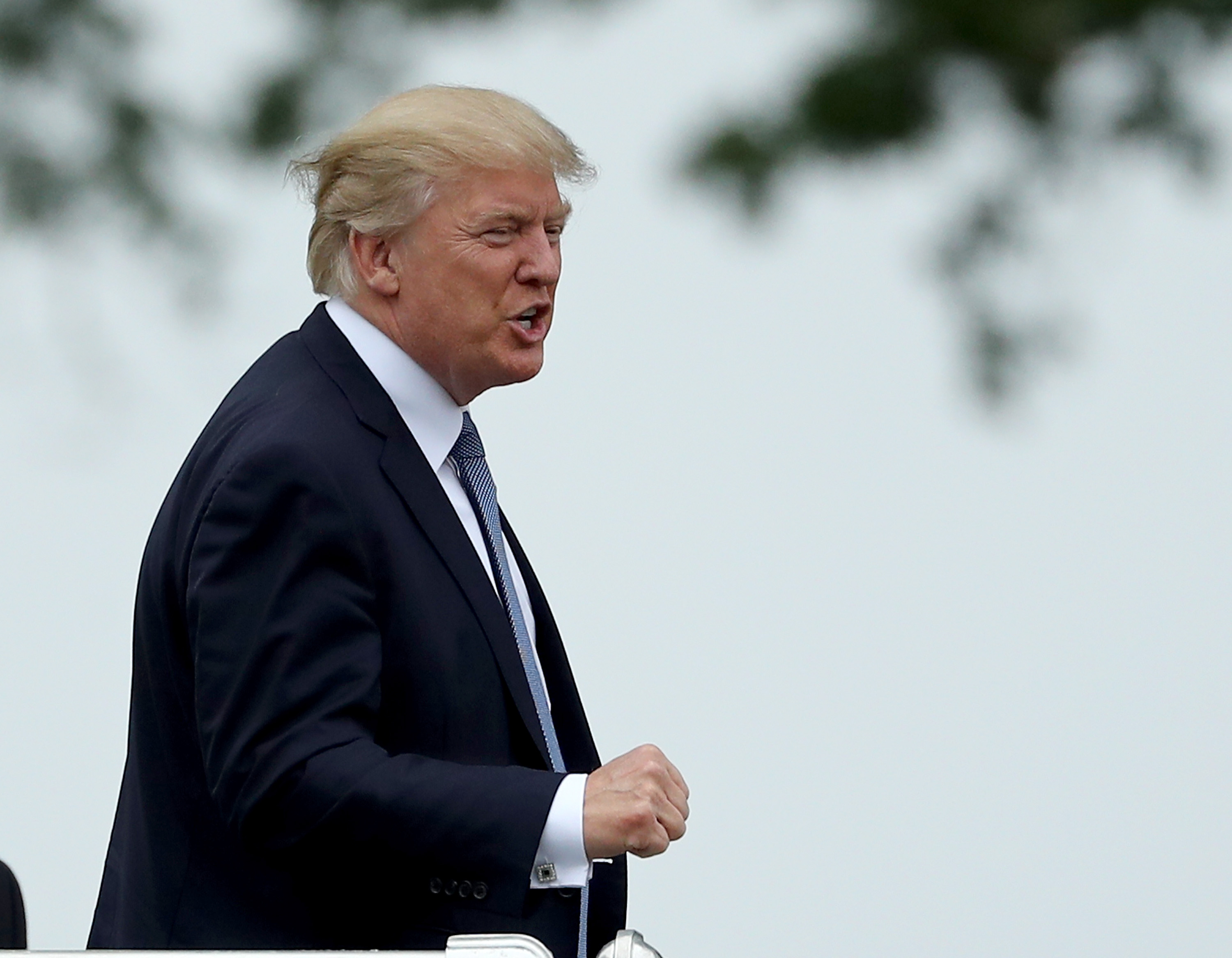 President Donald Trump acknowledges the patrons in the clubhouse as he leaves the U.S. Women's Open round two on July 14, 2017 at Trump National Golf Course in Bedminster, New Jersey.