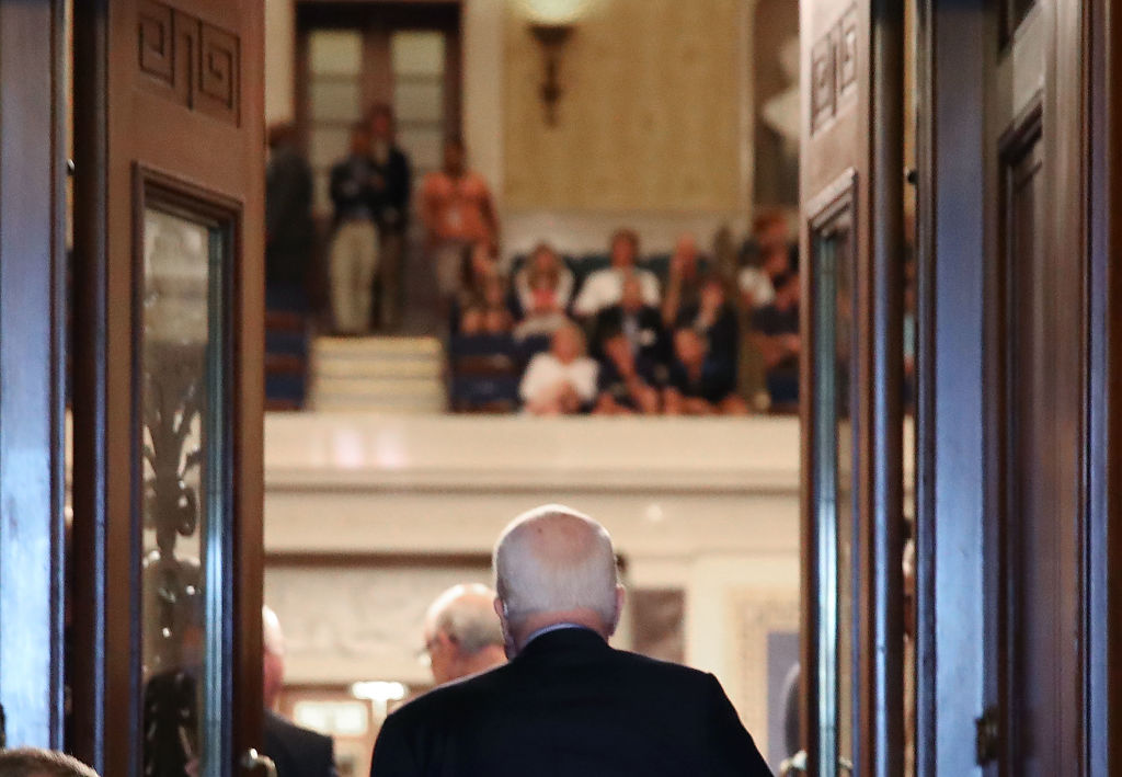 Sen. John McCain walks into the U.S. Senate chamber on July 25, 2017 in Washington, DC.