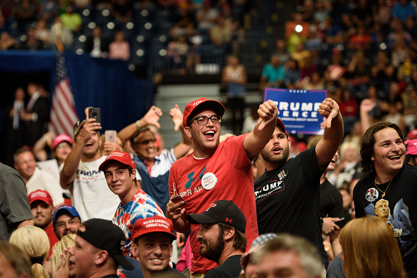 Supporters of U.S. President Donald Trump jeer the media at the Covelli Centre on July 25, 2017 in Youngstown, Ohio.