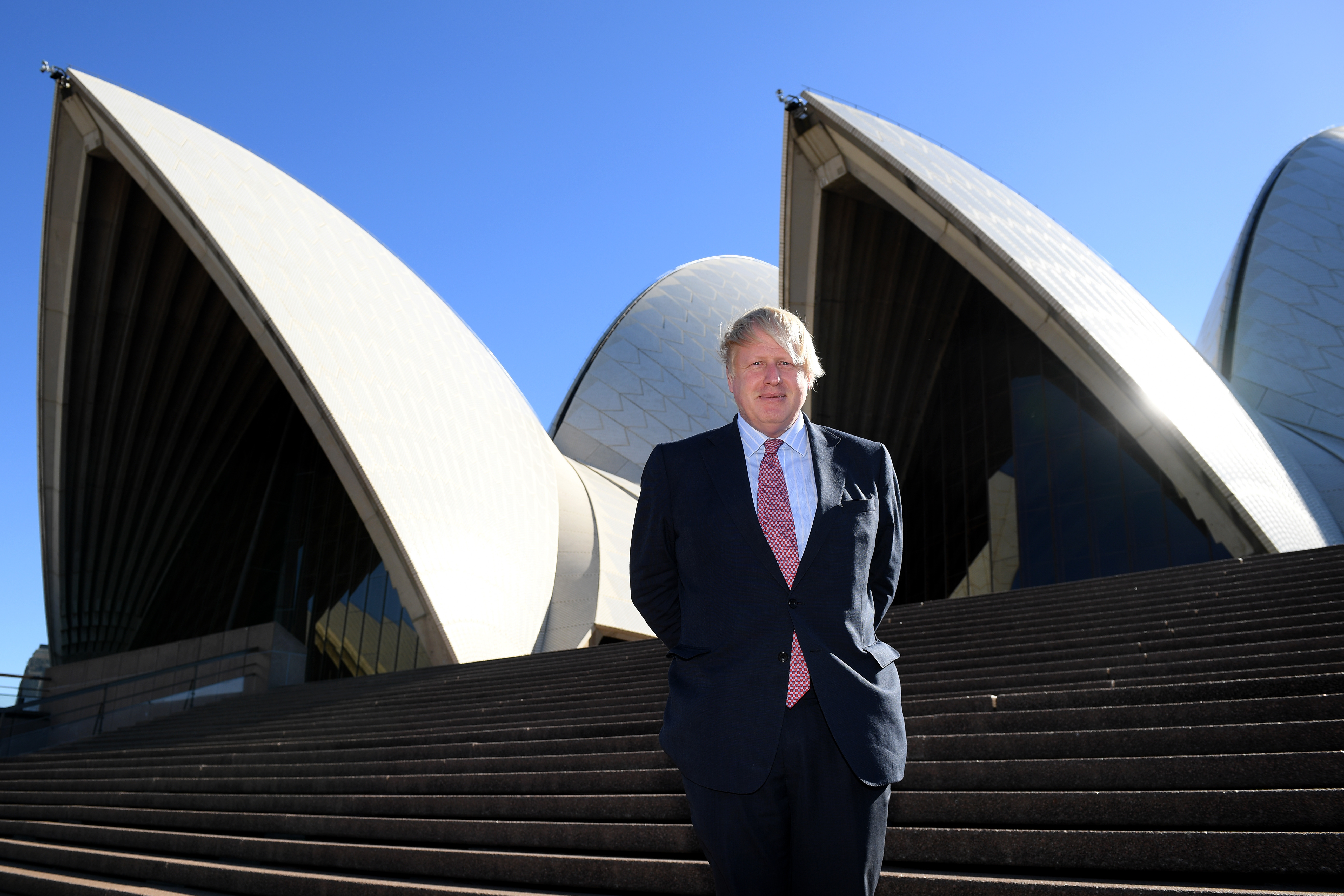 Boris Johnson poses on the stairs of the Sydney Opera House, July 26, 2017.