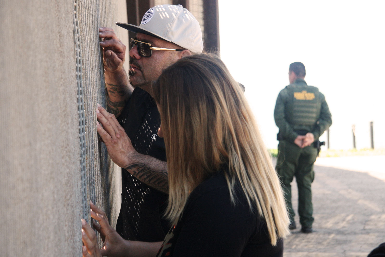 Saul Garcia and his cousin, Claudi Burrola, visit family members who aren't allowed entry into the U.S. Benjamin Preston—The Drive