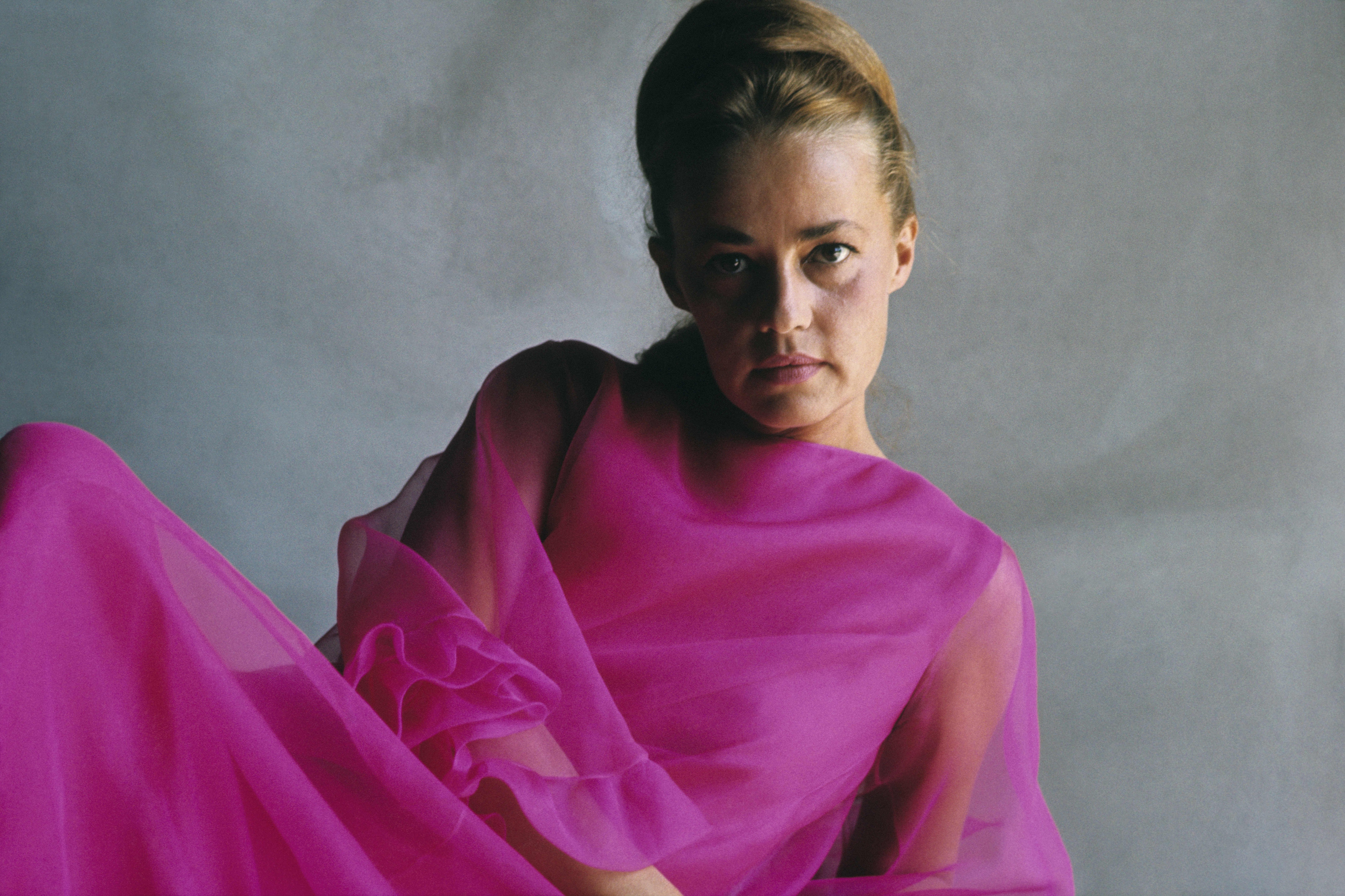 French actress Jeanne Moreau wearing a chiffon gown.