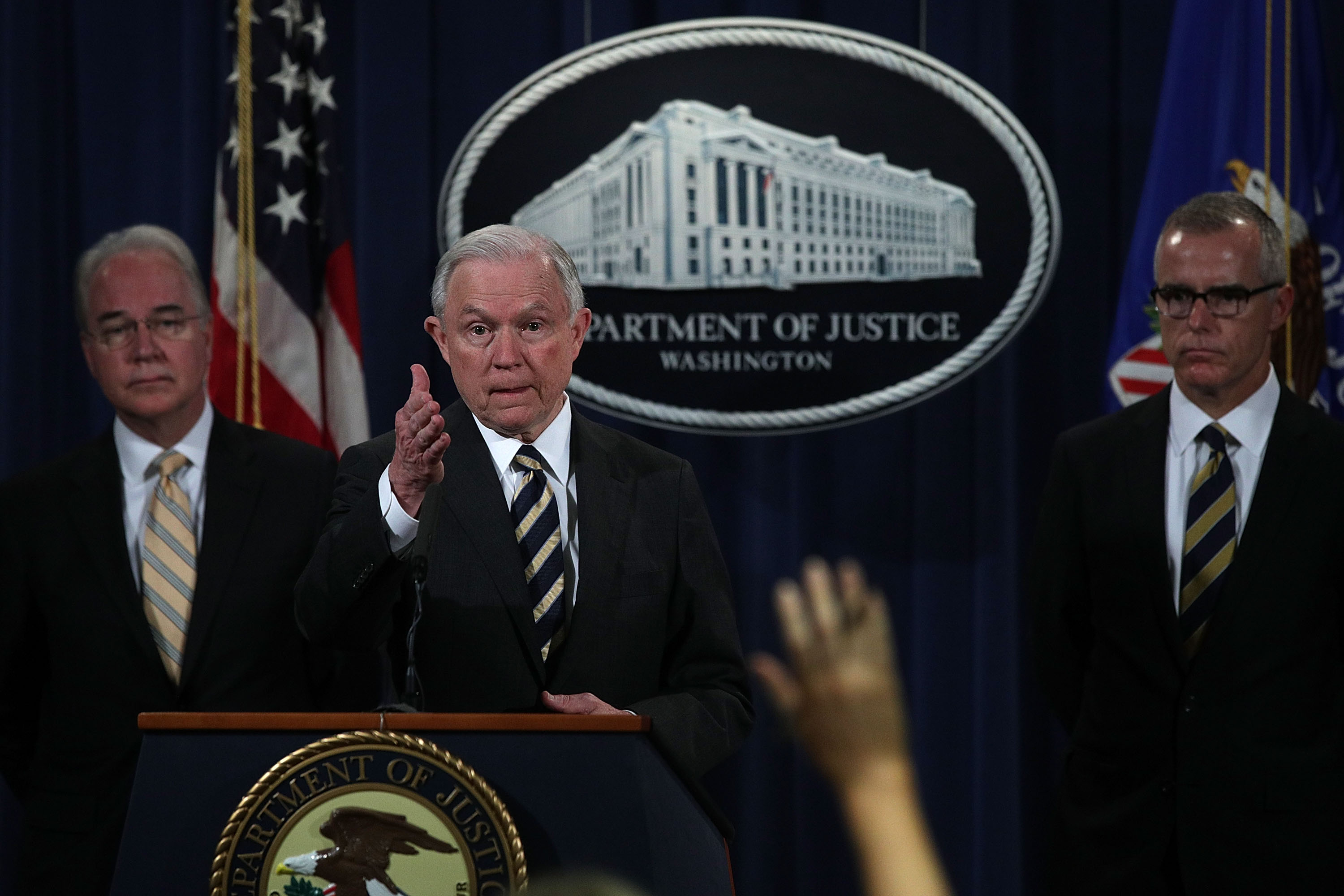 Attorney General Jeff Sessions takes questions as Acting FBI Director Andrew McCabe (R) and Secretary of Health and Human Services Tom Price (L) look on during a news conference to announce significant law enforcement actions July 13, 2017 at the Justice Department in Washington, D.C.