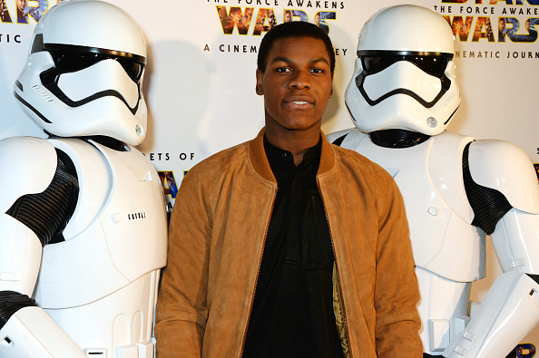 John Boyega poses with Stormtroopers at the UK Gala Screening of 'Secrets Of The Force Awakens: A Cinematic Journey' at Picturehouse Central on March 29, 2016 in London, England.