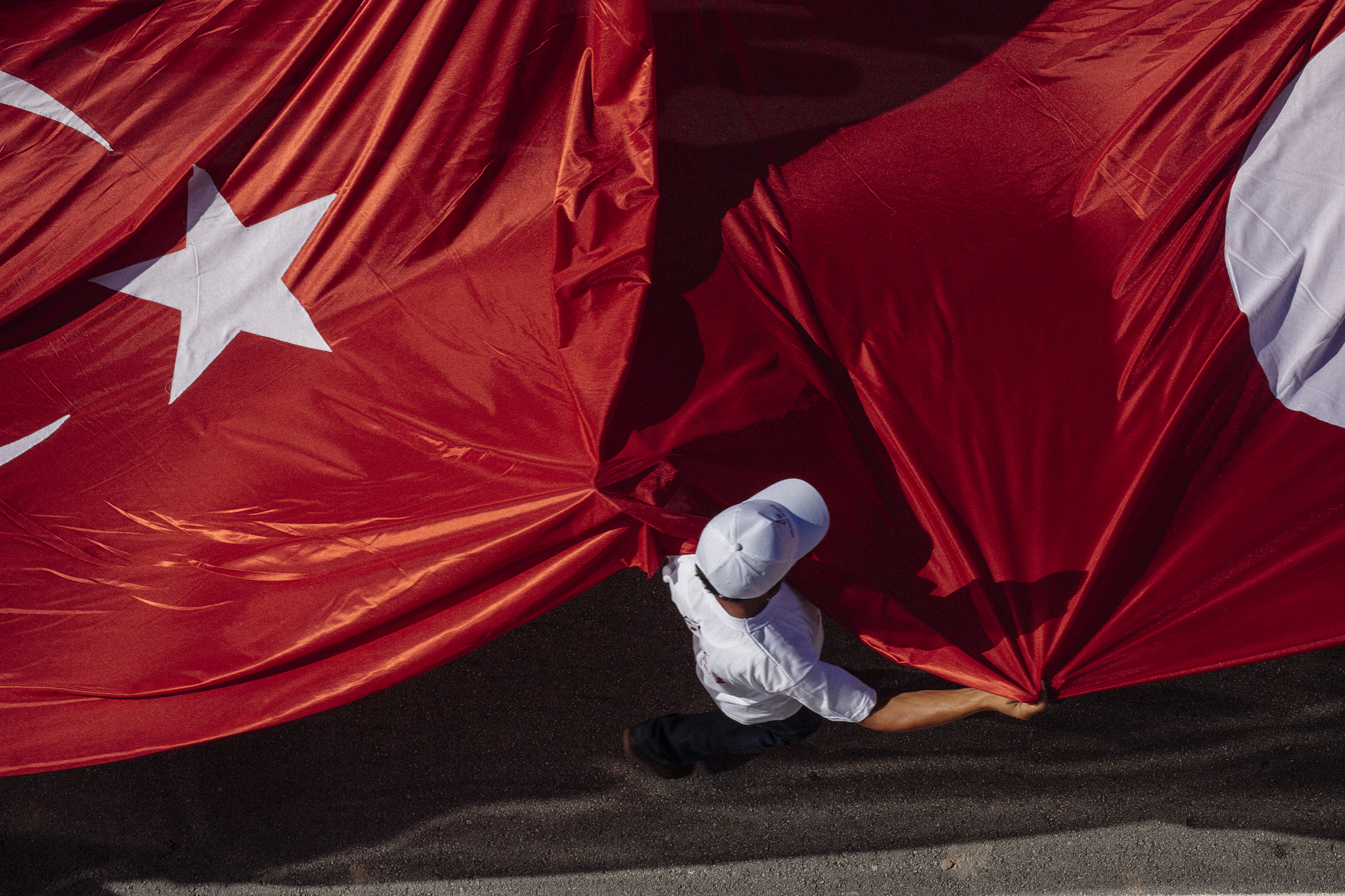A Turkish flag is carried by demonstrators during the Justice March, a walk from Ankara to Istanbul, July 1, 2017, in protest of the government of President Recep Tayyip Erdogan.
