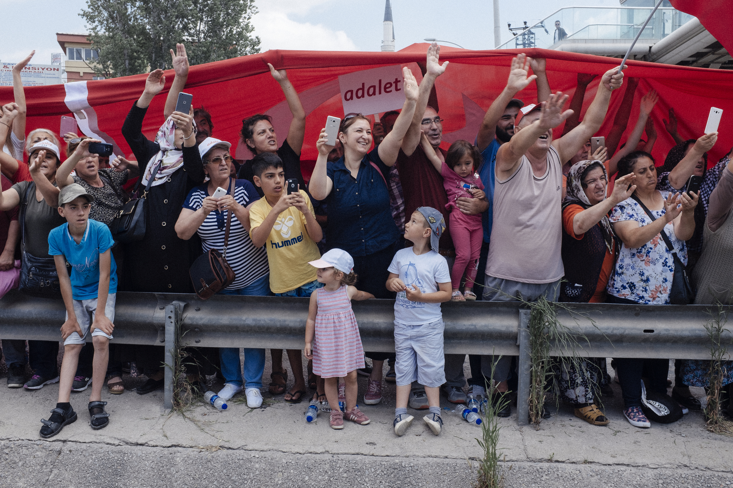 Supporters wave to the demonstrators near a highway as the March for Justice made their way to Istanbul, Turkey, July 7, 2017.