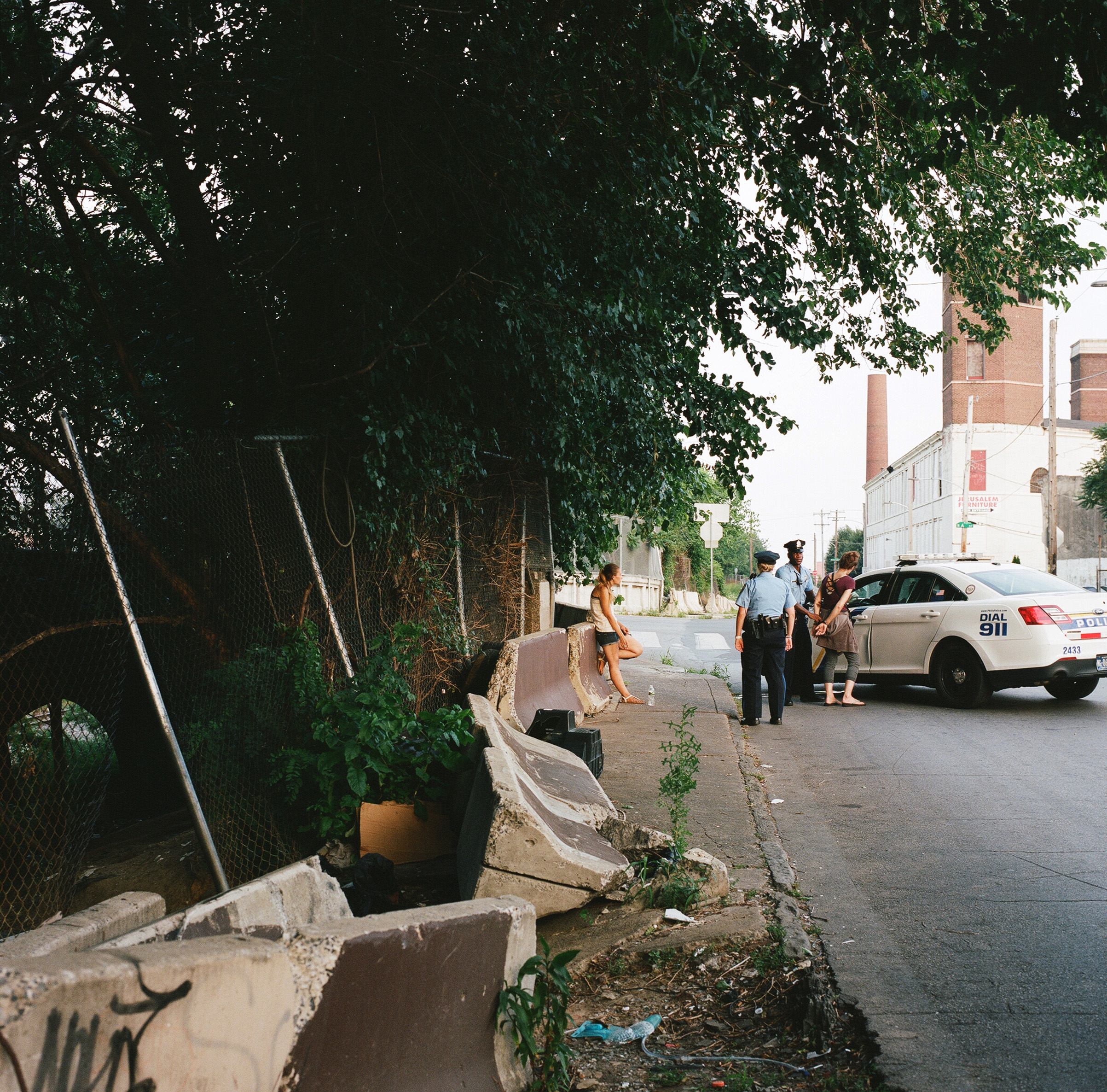 Officers question two women on Gurney Street in Kensington before releasing them.