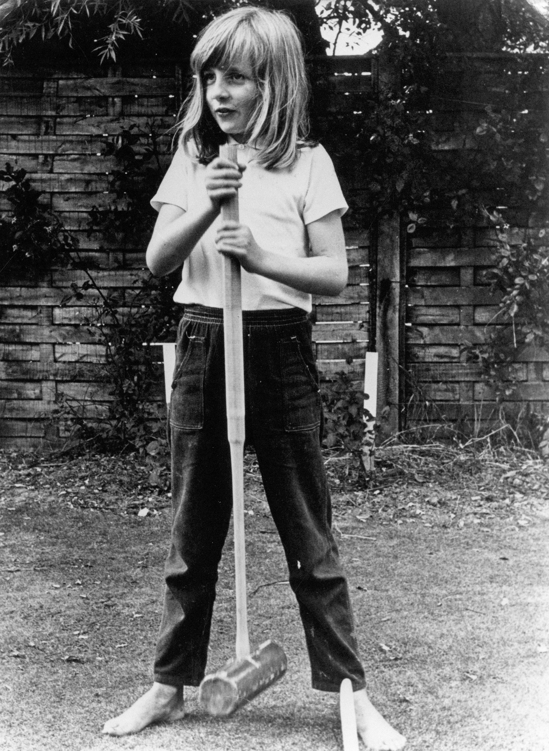 Lady Diana Spencer poses barefoot with a croquet mallet circa 1970 at Itchenor Sussex.