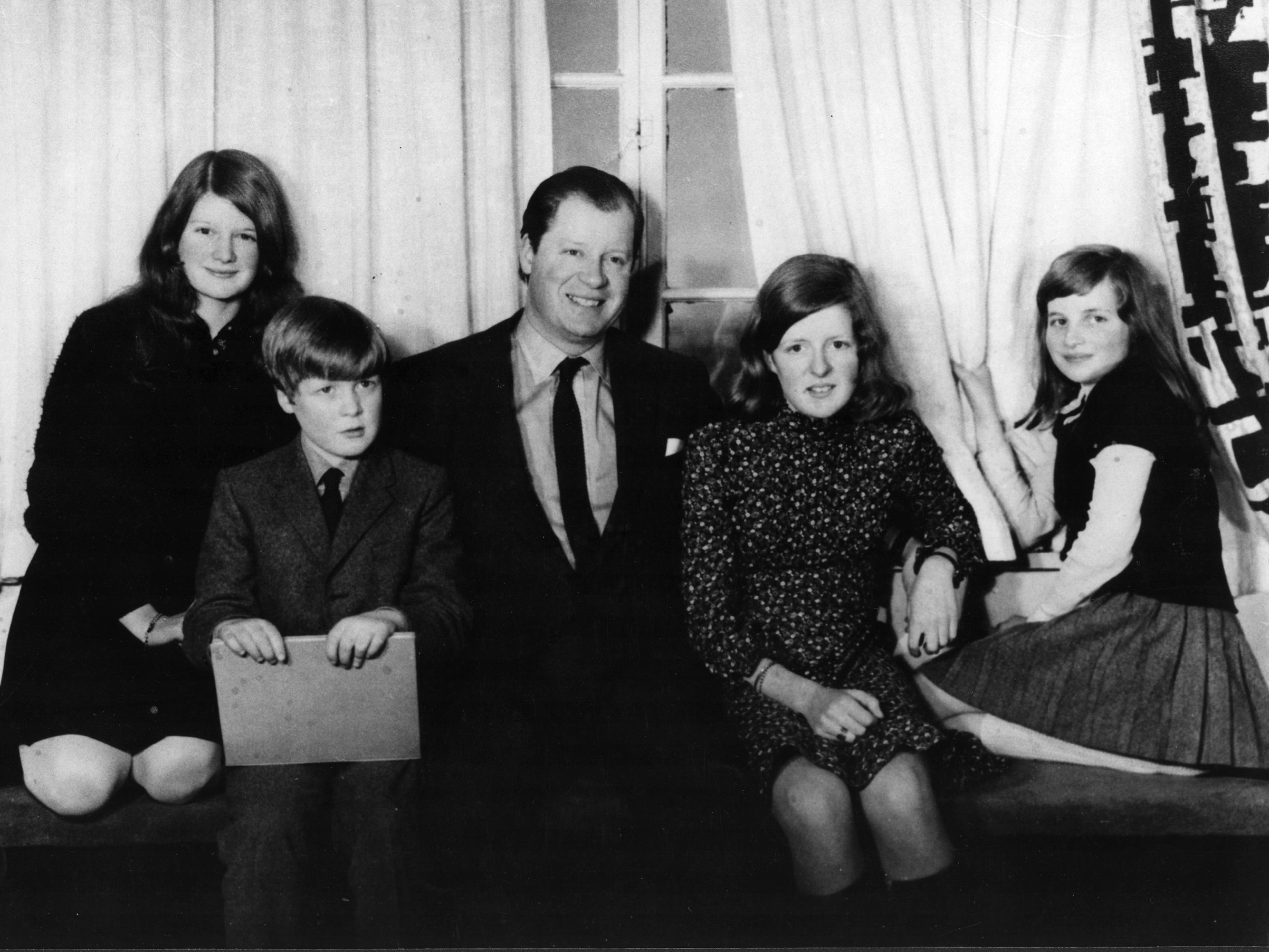 A portrait of the Spencer family; (L-R) Lady Sarah Spencer, Viscount Spencer, Earl Spencer, Lady Jane Spencer and Lady Diana Spencer at home.