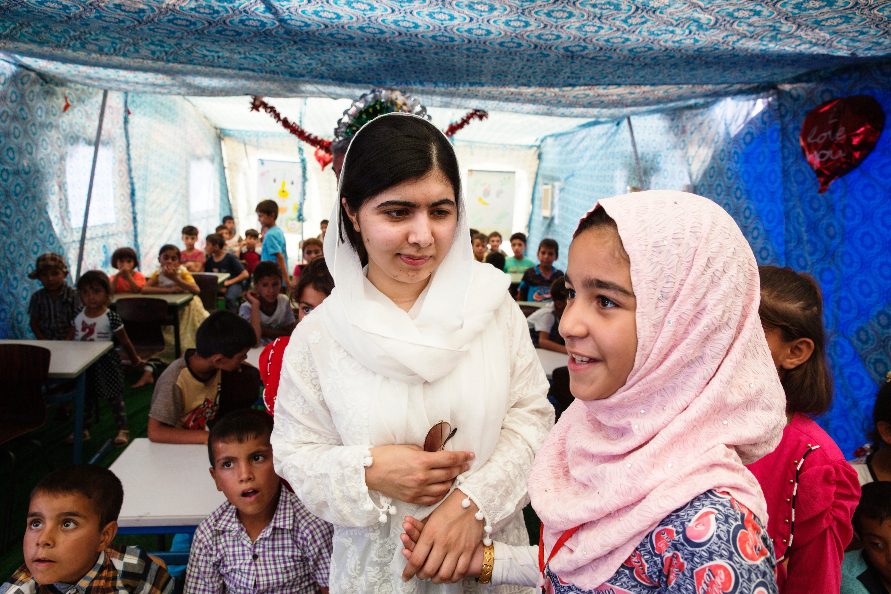 Malala Yousafzai visits children, who are back in school after living in ISIS-controlled Mosul, at a refugee camp on July 11, 2017.