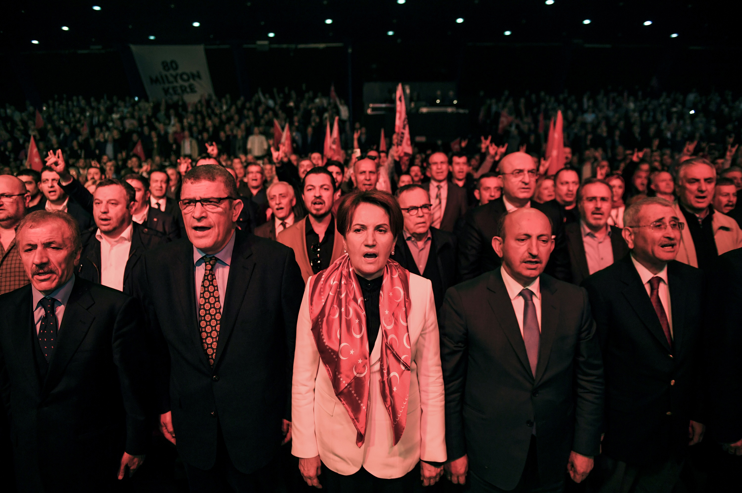 Meral Aksener, center, sings the national anthem as she attends a  NO  campaign meeting on March 28, 2017.
