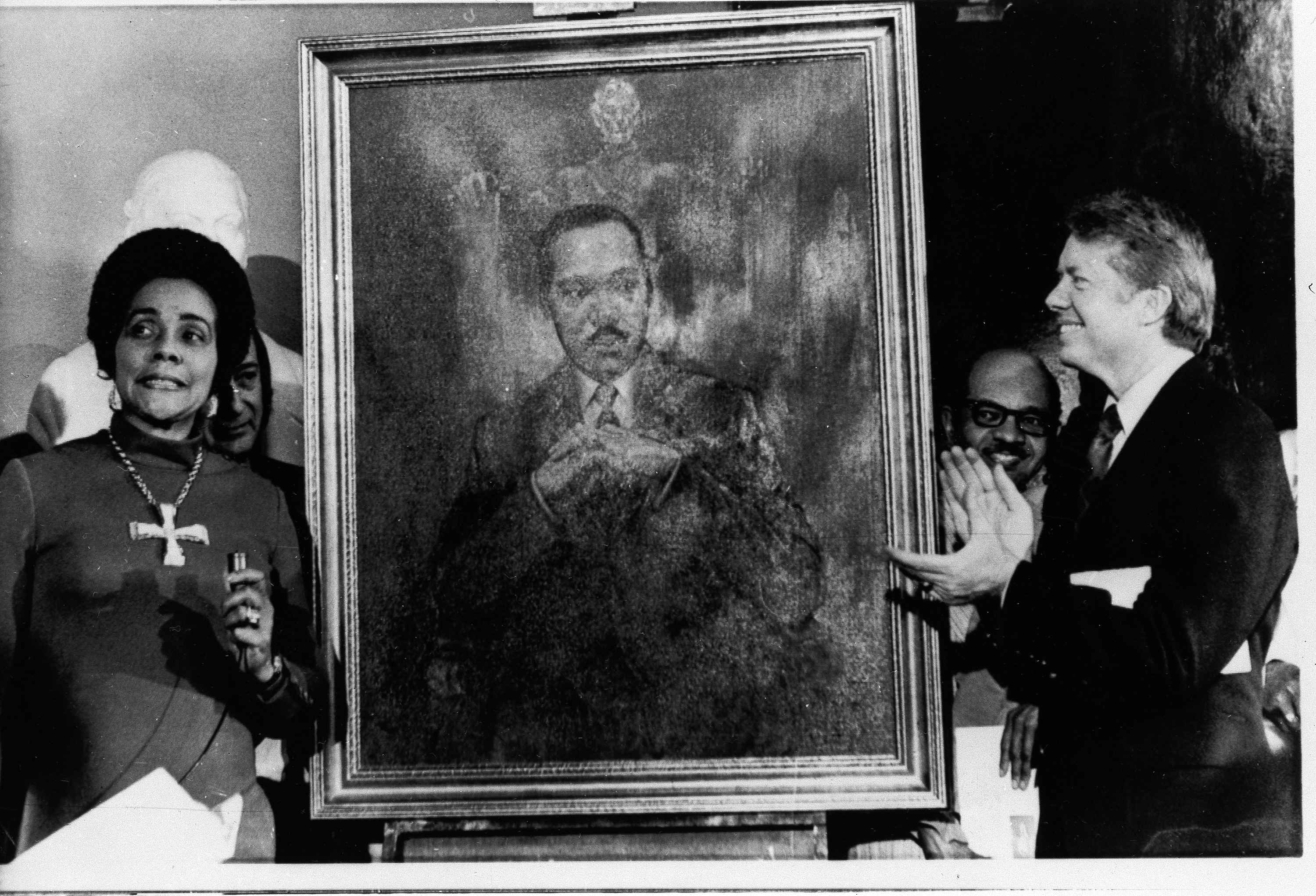 Coretta Scott King, widow of slain civil rights leader Dr. Martin Luther King, Jr., speaks at an unveiling of a portrait of Dr. King by artist George Mandus, Feb. 18, 1974, and dedicated by Gov. Jimmy Carter.
