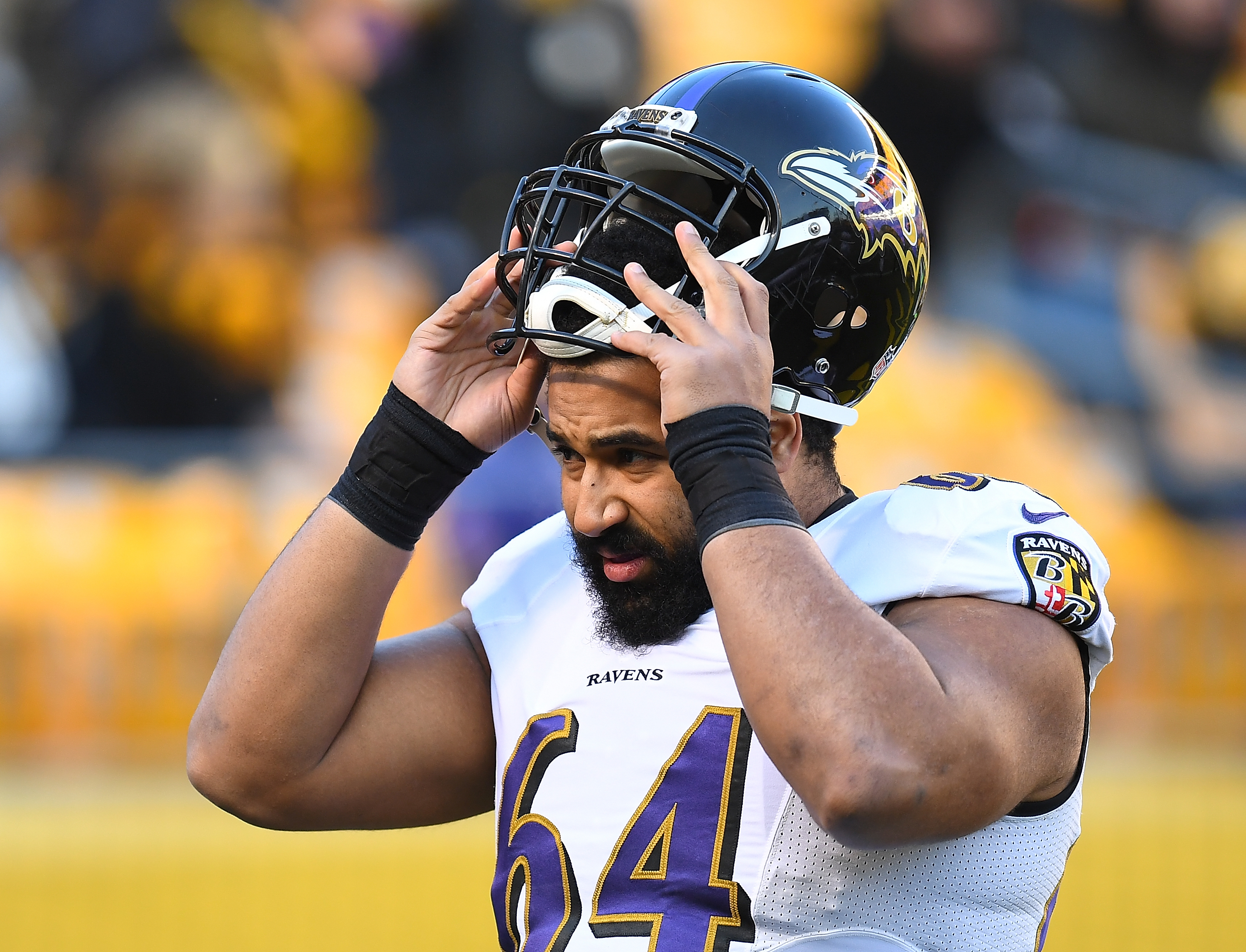 John Urschel of the Baltimore Ravens looks on during the game against the Pittsburgh Steelers at Heinz Field on December 25, 2016 in Pittsburgh, Pennsylvania.