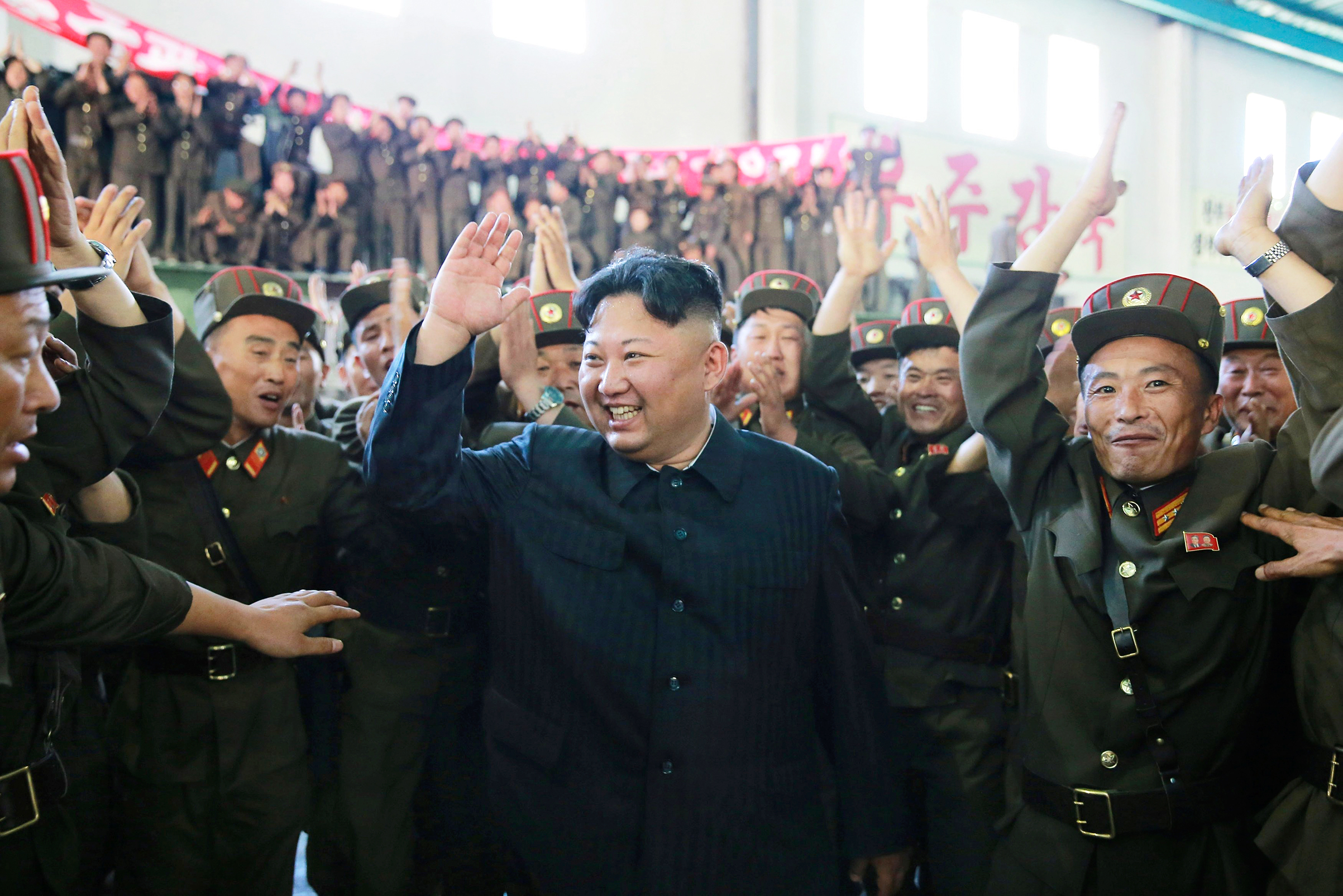 Kim celebrates the test launch of the Hwasong-14 ICBM in this photo released by the North Korean government on July 5