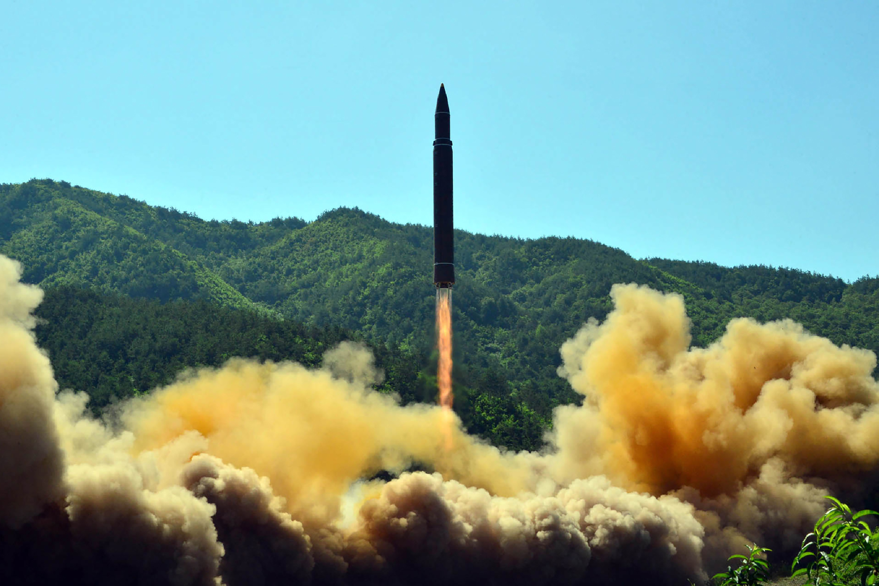 This picture released by North Korea's official Korean Central News Agency (KCNA) on July 5, 2017 shows the successful test-fire of the intercontinental ballistic missile Hwasong-14 at an undisclosed location.