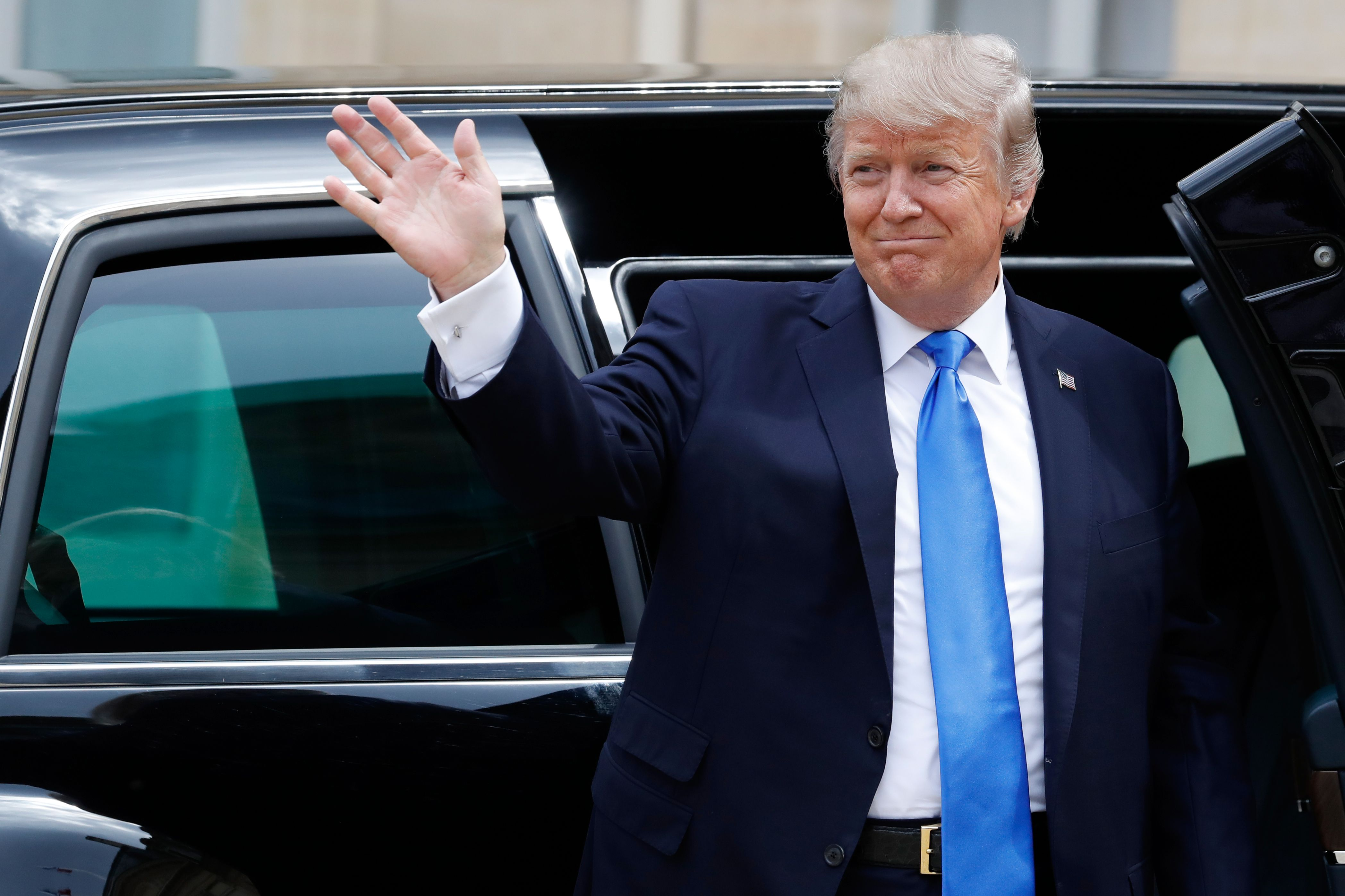 US President Donald Trump gets out of the car as he arrives at the Elysee Palace on July 13, 2017 in Paris for a 24-hour trip that coincides with France's national day and the 100th anniversary of US involvement in World War I.