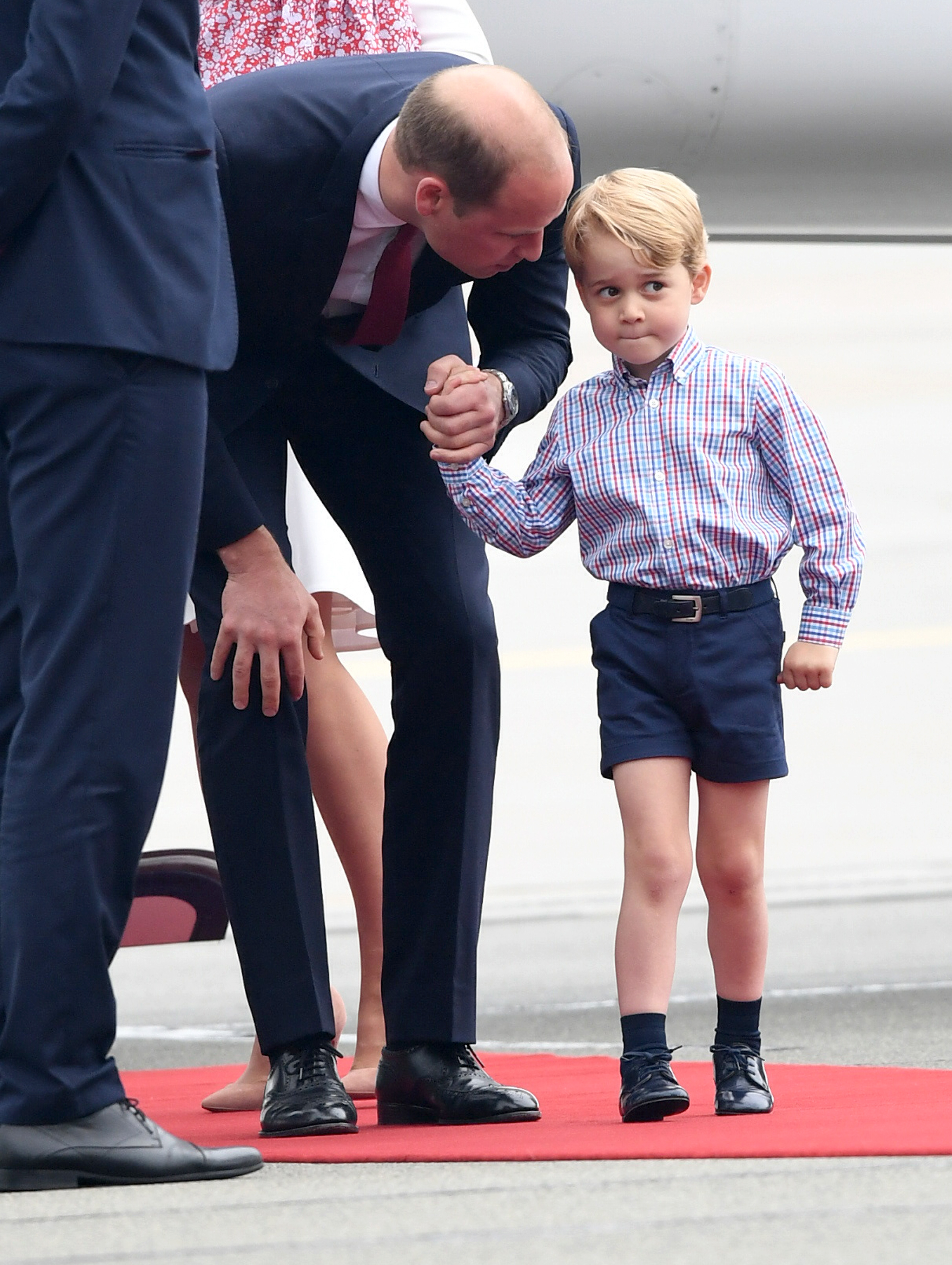 Prince William, Duke of Cambridge and Prince George of Cambridge as they arrive with Catherine, Duchess of Cambridge and Princess Charlotte of Cambridge on day 1 of their official visit to Poland on July 17, 2017 in Warsaw.