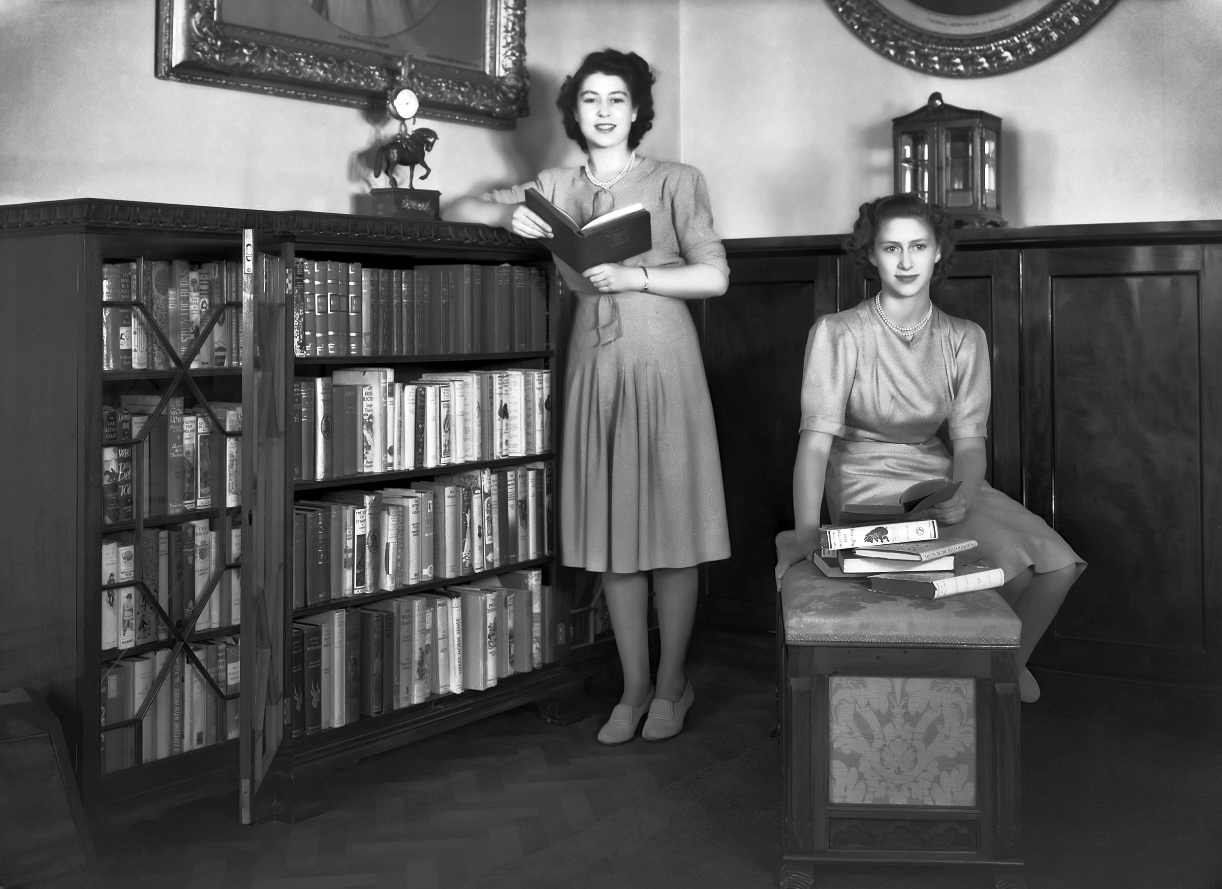 Then-Princess Elizabeth and her sister Princess Margaret in a library in Buckingham Palace on July 19, 1946.