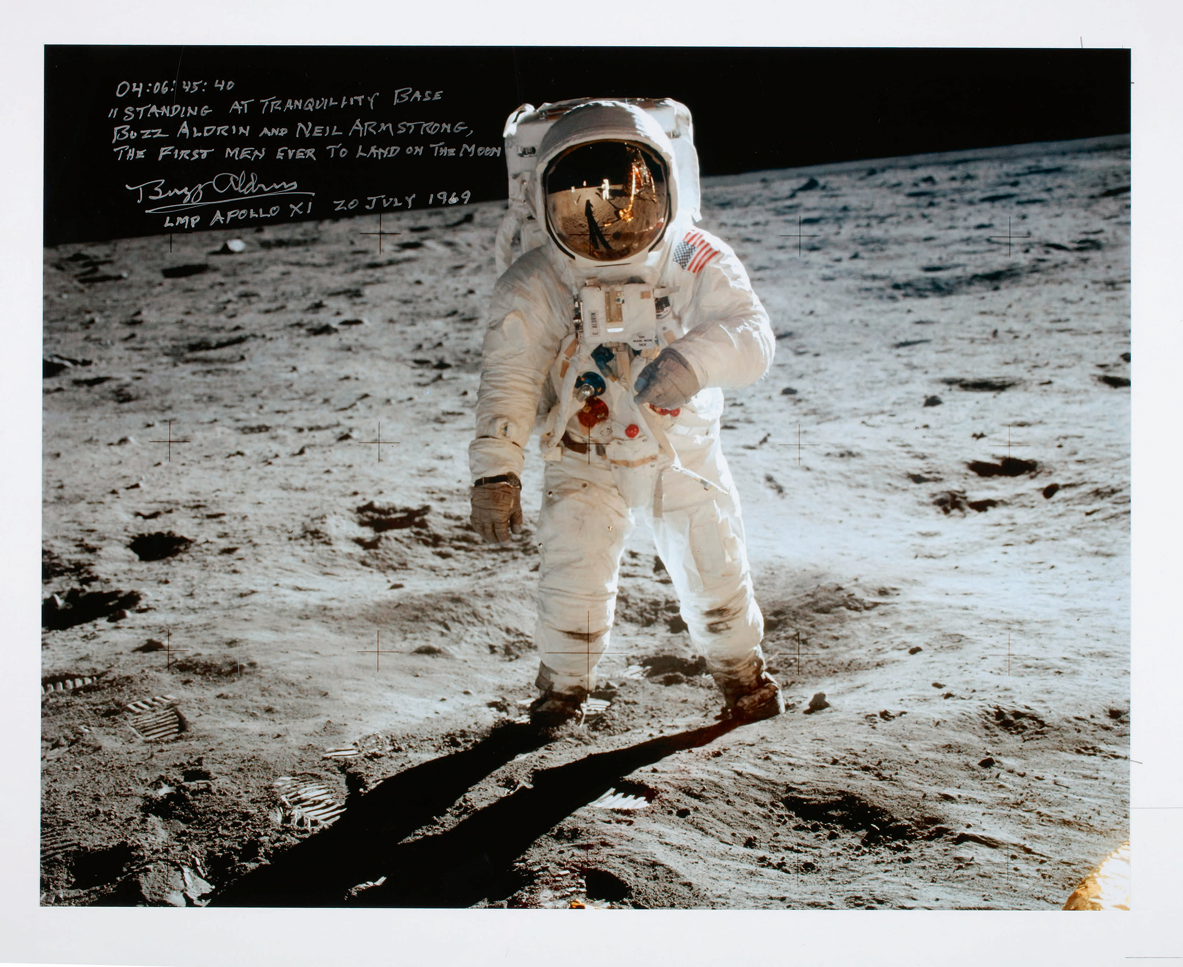 Buzz Aldrin at Tranquility Base. The Apollo program's most iconic image. Large color photograph taken by Neil Armstrong of Buzz Aldrin during their Apollo 11 moonwalk. Signed & inscribed by Buzz Aldrin.