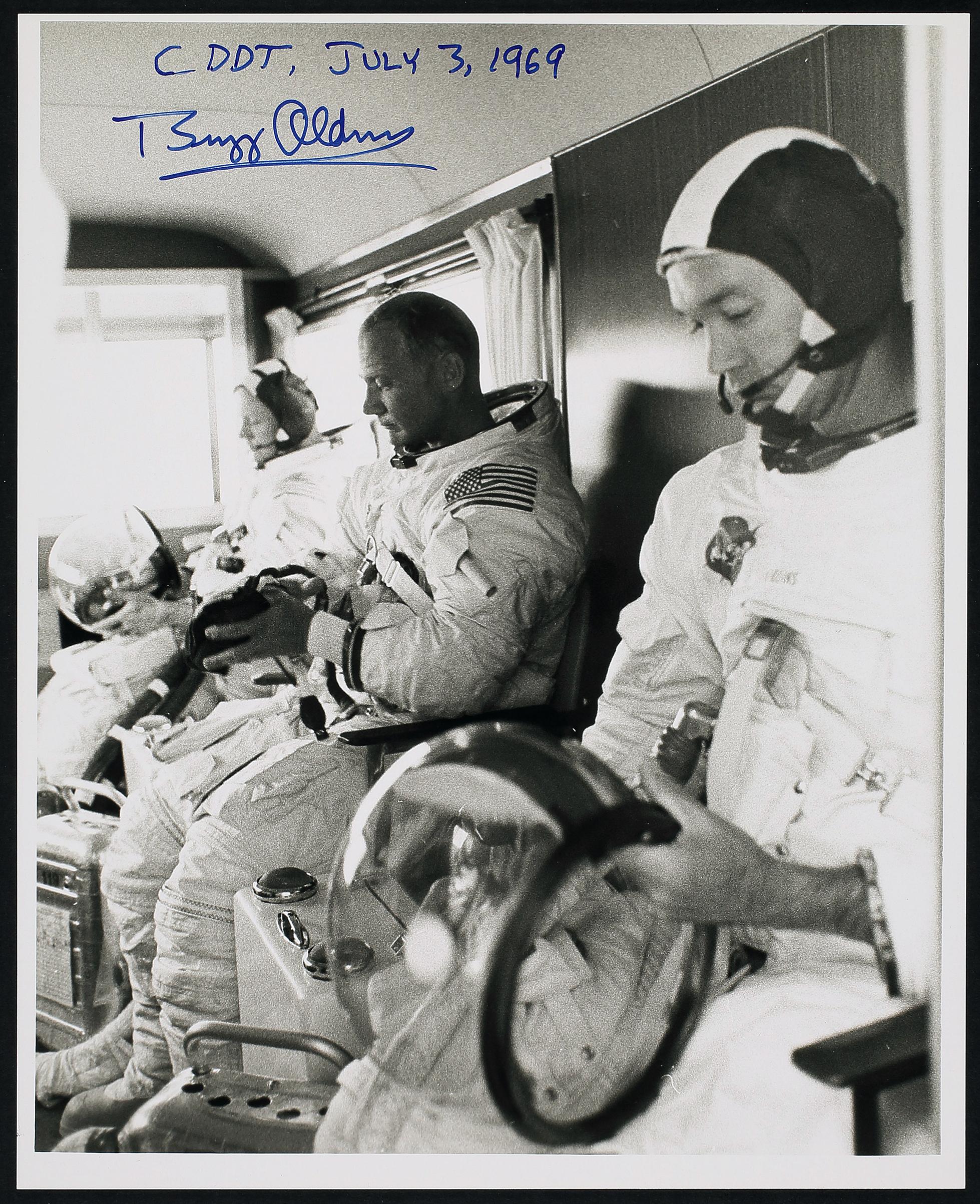 NASA Apollo 11 Press Release Photograph Collection. Contains 10 photos, with 4 signed by Buzz Aldrin.