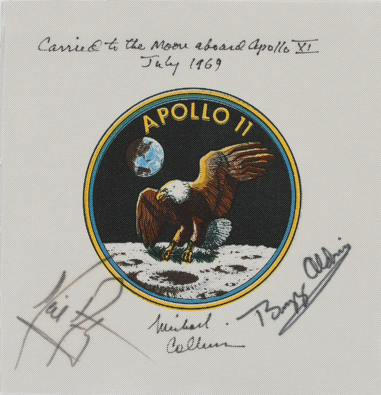 Flown to the Moon on Apollo 11-Command Module Pilot Michael Collins' Crew-Signed Apollo 11 Emblem. One of the very flew flown Apollo 11 mission artifacts to be signed by Neil Armstrong.