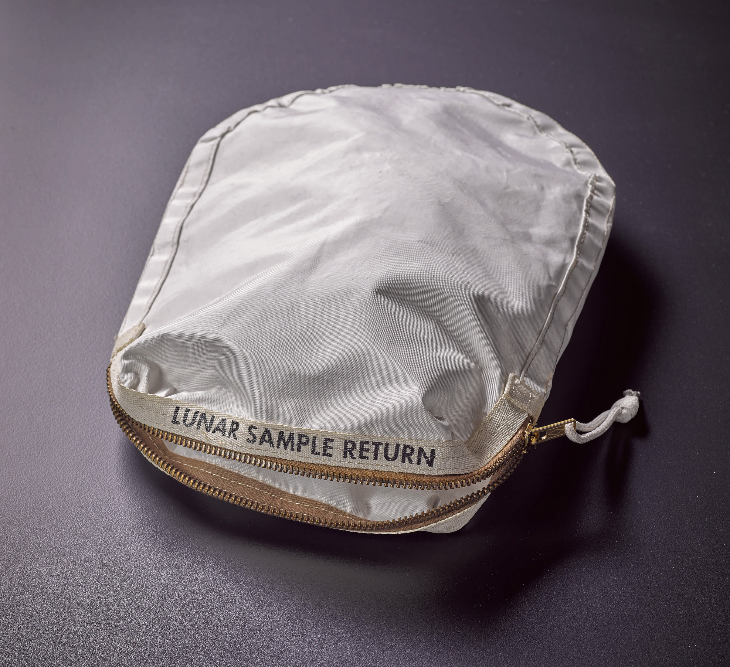 Apollo 11 Contingency Lunar Sample Return Bag. Used by Neil Armstrong on Apollo 11 to bring back the very first pieces of the moon ever collected, traces of which remain in the bag.