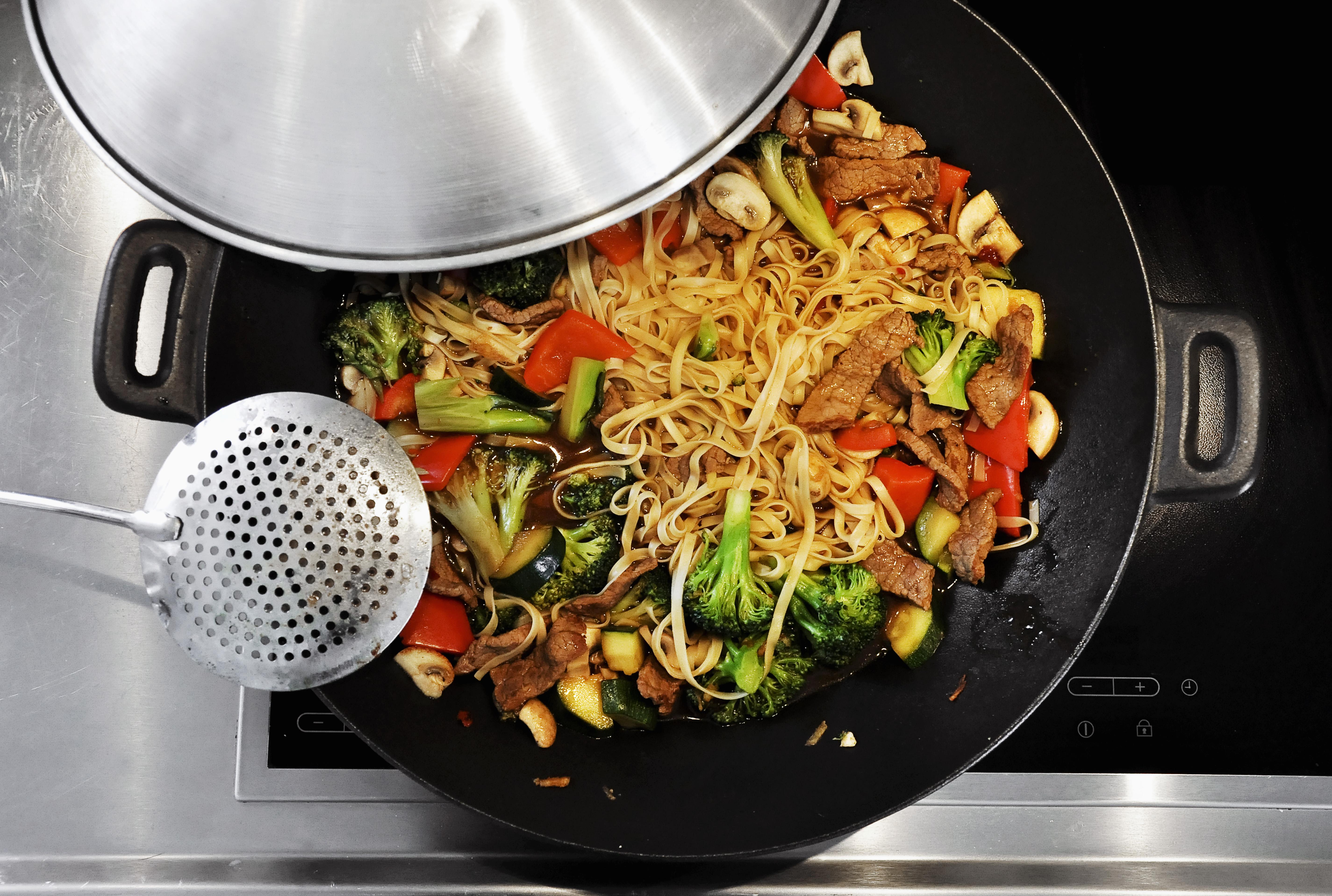 Cooking vegetable stir-fry in a wok