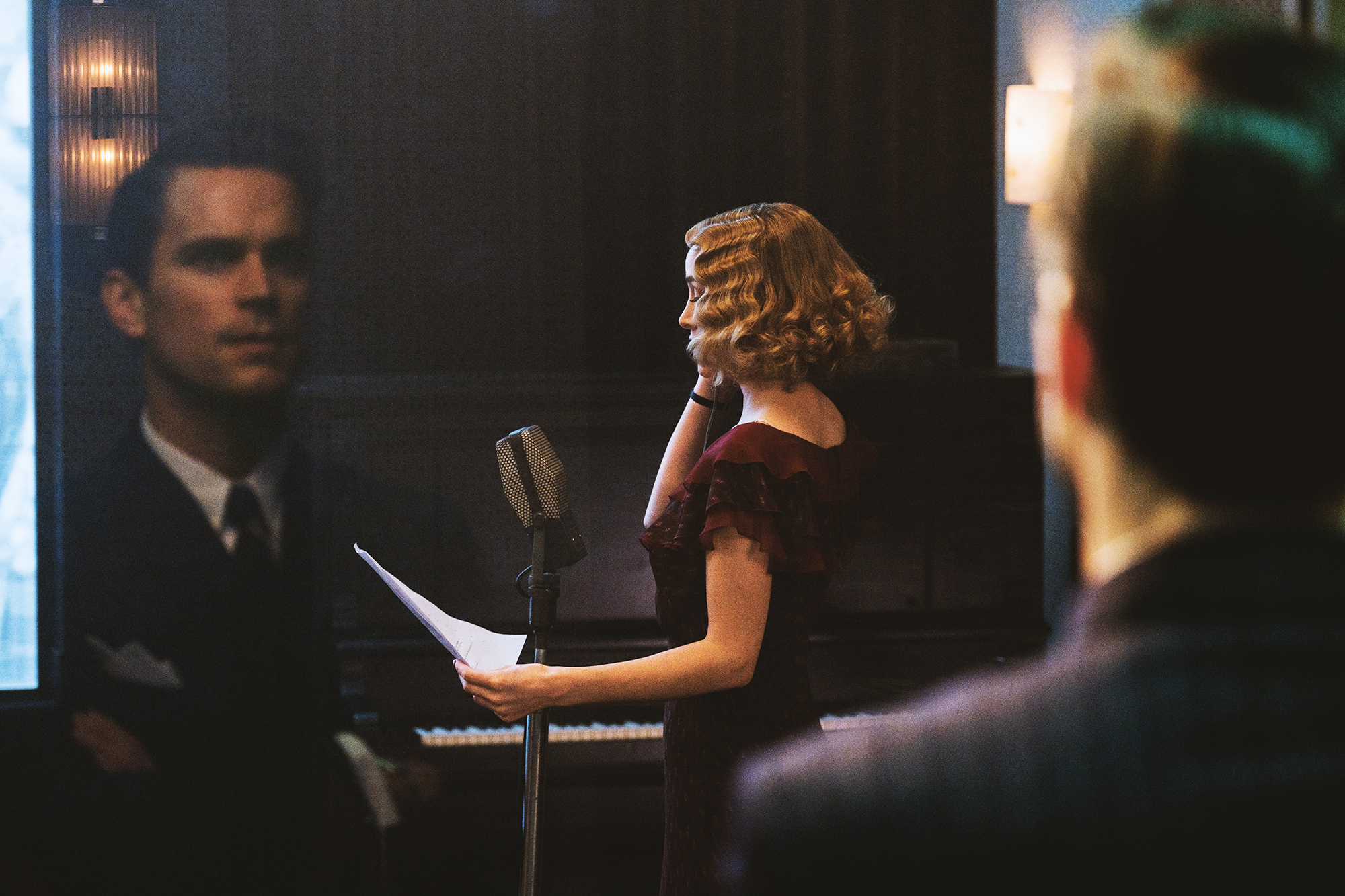 Bomer, playing a genius producer with a hand in everything, watches over his stars