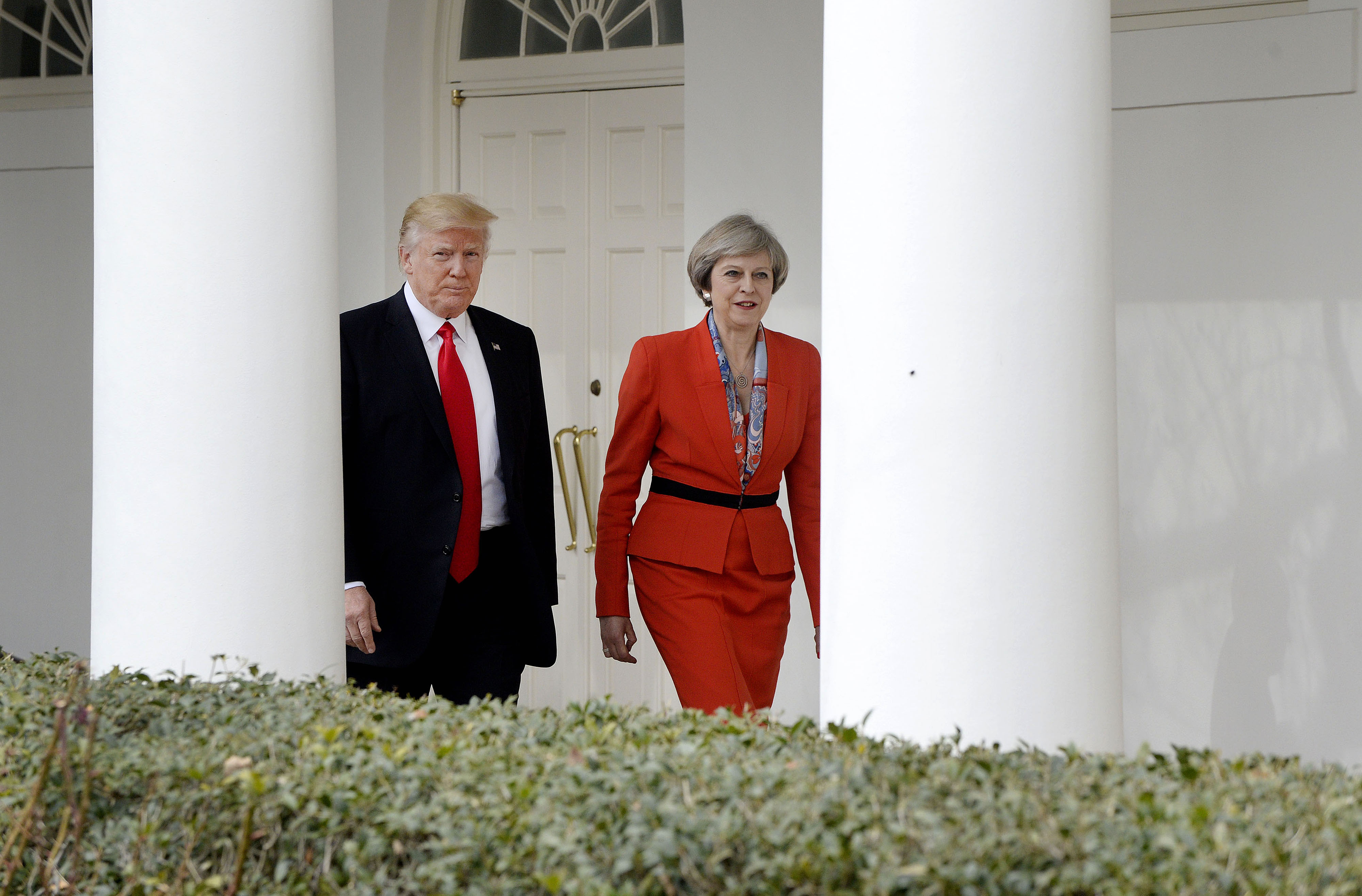 President Donald Trump, left, walks with Theresa May, U.K. prime minister, outside of the White House in Washington, on Jan. 27, 2017.