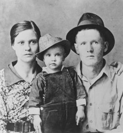 Elvis Presley poses for a family portrait with his parents Vernon Presley and Gladys Presley in 1937 in Tupelo, Mississippi.