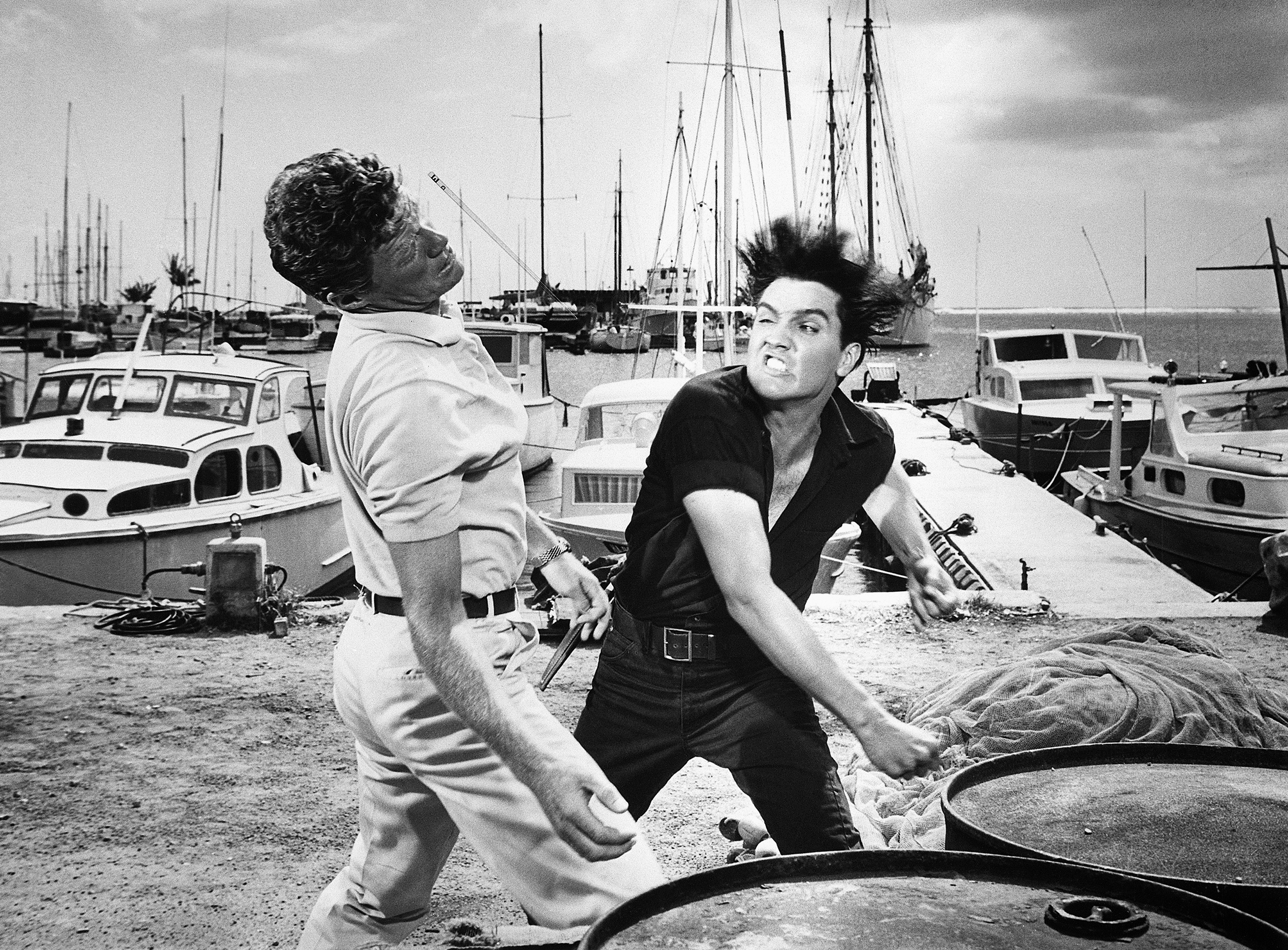 Girls! Girls! Girls! : 1962, Elvis in a scene where he throws a punch to Jeremy Slate.
