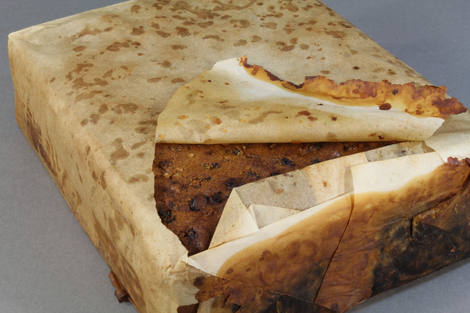 Antarctic Heritage Trust conservators found a 100 year old fruit cake among the artefacts from Cape Adare.