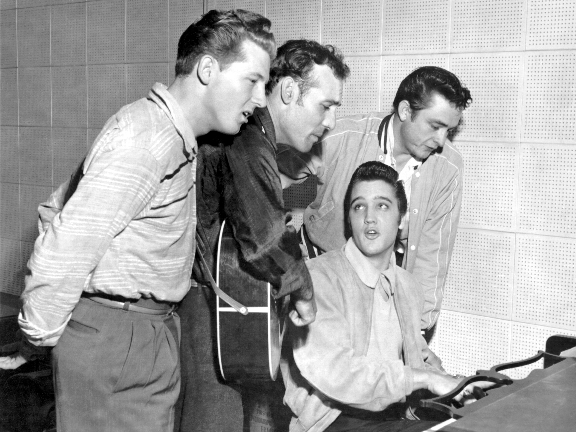 Rock and roll musicians Jerry Lee Lewis, Carl Perkins, Elvis Presley and Johnny Cash as  The Million Dollar Quartet  Dec. 4, 1956 in Memphis, Tenn. This was a one night jam session at Sun Studios.