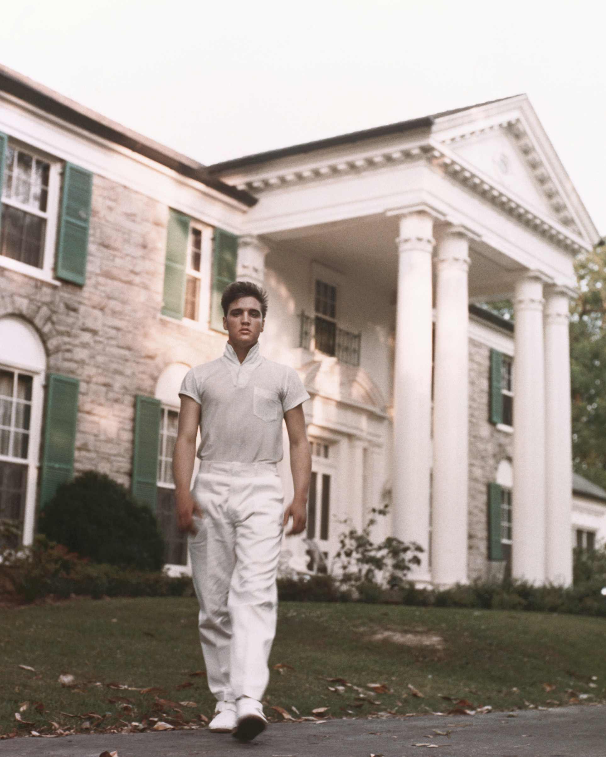 Elvis strolls the grounds of his Graceland estate in Memphis, Tenn. circa 1957.