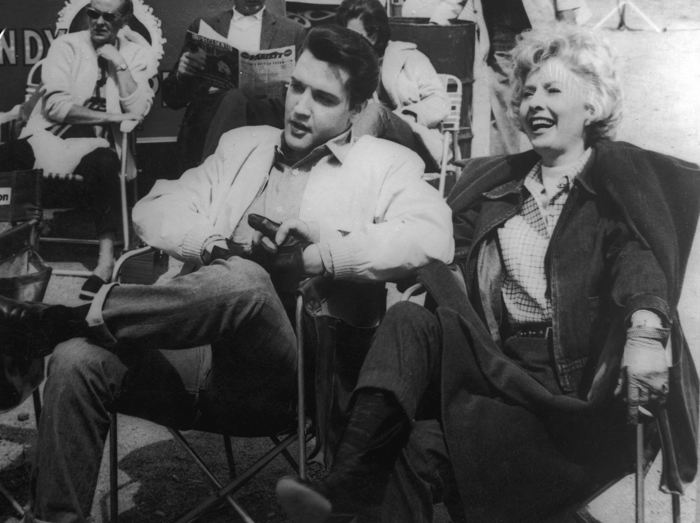 Roustabout : 1964, Elvis holding hands with co-star Barbara Stanwyck between takes.